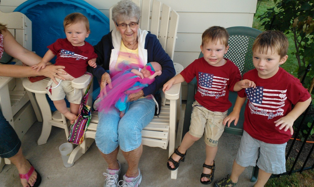 Madelyn, whose potato soup recipe is part of her legacy, spends time with her great-grandkids.