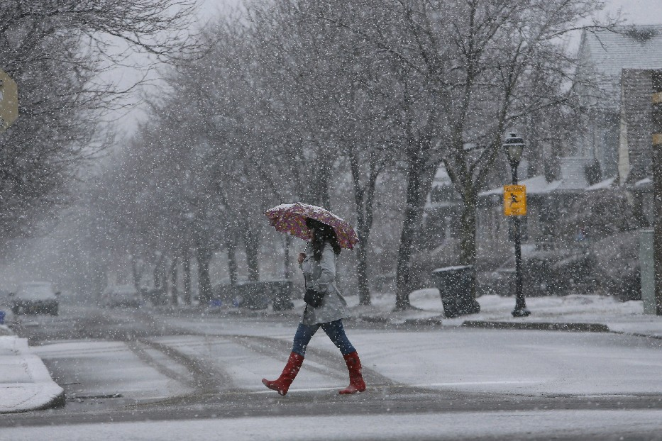Heather Stone crosses Shepard Avenue in Kenmore while walking down Delaware Avenue in heavy snow, Thursday, March 26, 2015. (Derek Gee/Buffalo News)