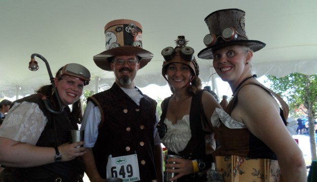 University of Maine Machias alumni, from left, Katie Archambault, Jimmy Kroon, Kathleen Kulig and Lori Brown make a weekend of the Dogfish Dash, and are among those who show up in costume. (Scott Scanlon/Special to the News)