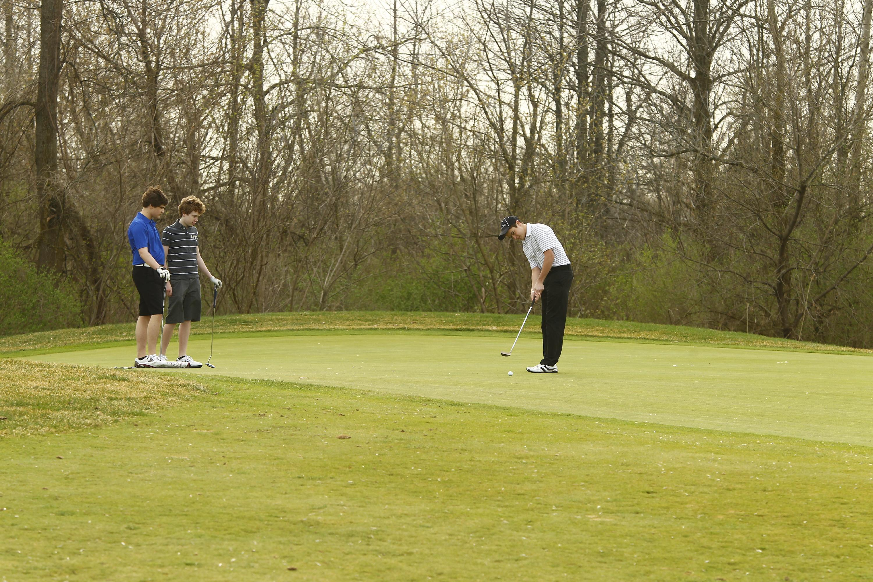 Unusually warm spring weather in 2012 allowed folks to hit the links as early as mid-March. Not only has that not yet happened this spring, but the temperature hasn't touched 60 degrees. (Buffalo News file photo)