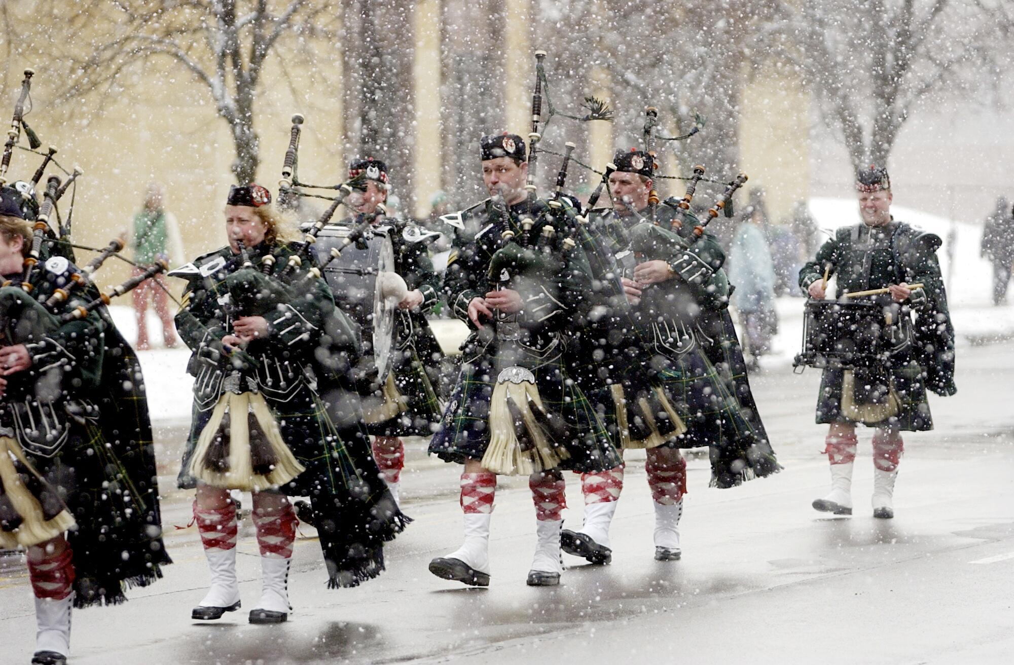Three years ago, heavy snow fell during the St. Patrick's Day parade in Buffalo. That scene could repeat itself this year as forecasters call for below-average days through the end of March. (Buffalo News file photo)