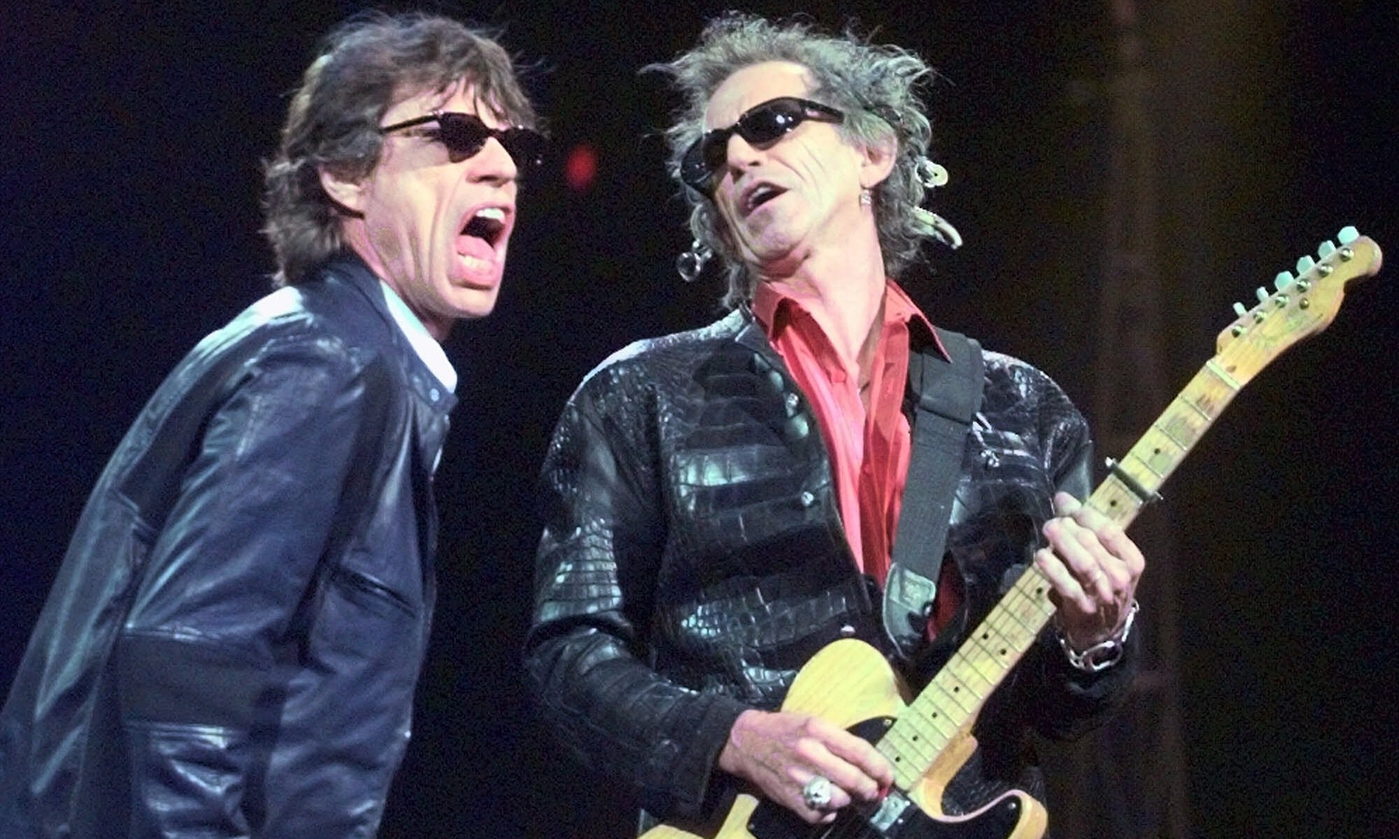 Mick Jagger, left, and Keith Richards perform 'Jumping Jack Flash' during the Rolling Stones' No Security Tour performance at the Fleet Center in Boston Monday night, March 22, 1999. (AP Photo/Elise Amendola)