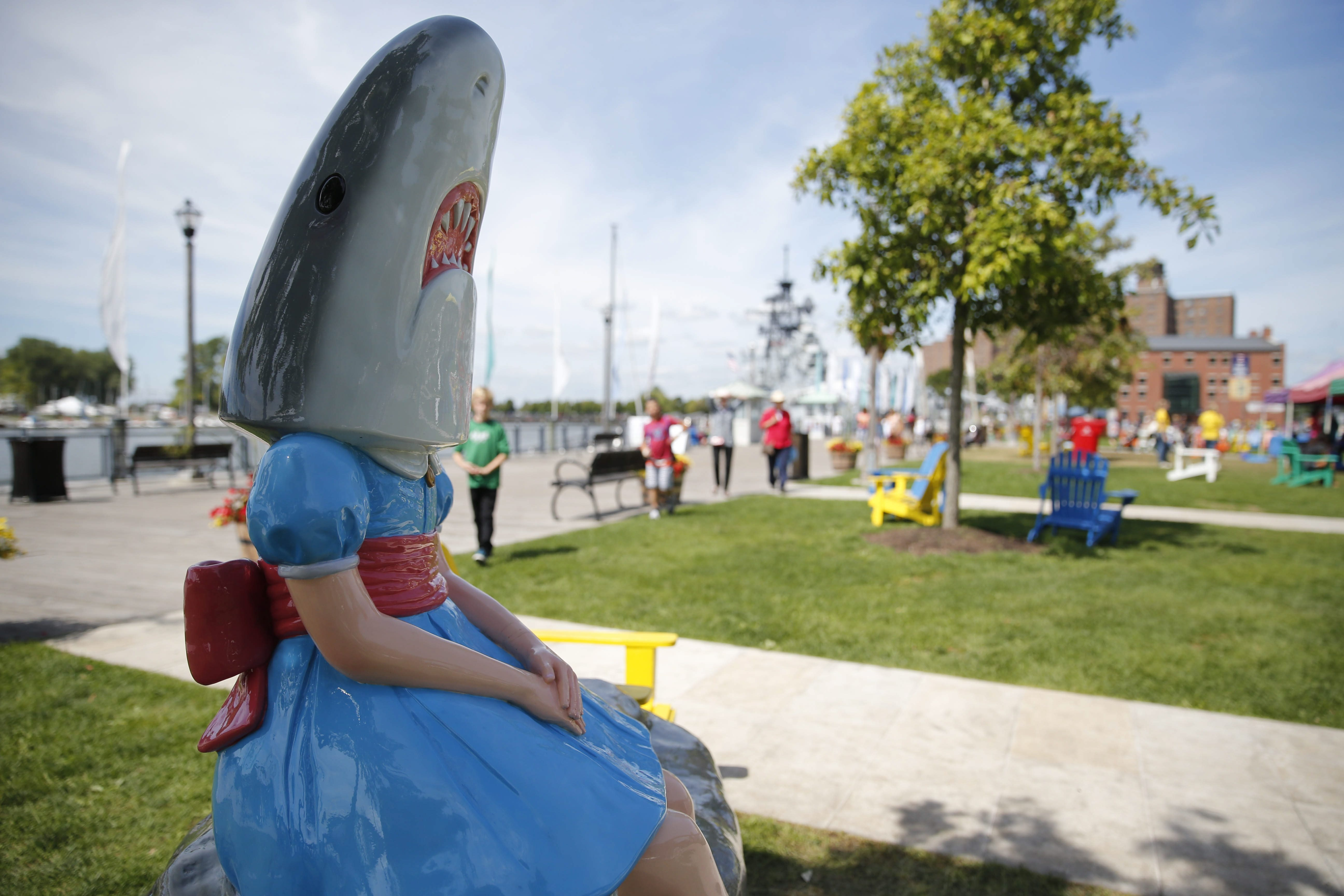 """The """"Shark Girl"""" statue at Canalside by artist Casey Riordan Millard has become a viral attraction since she was unveiled this week, Friday, Aug. 29, 2014.  (Derek Gee/Buffalo News)"""