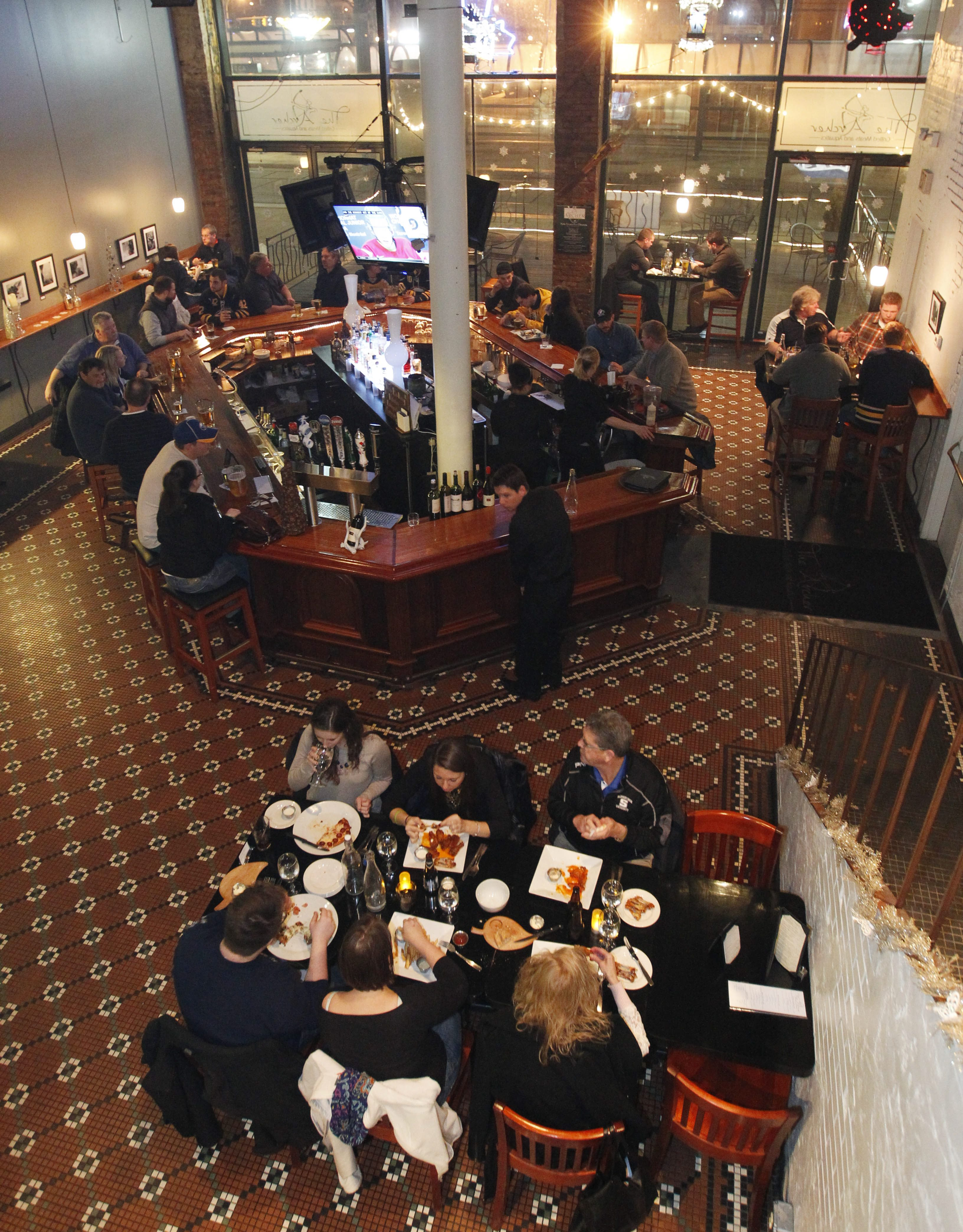 Customers hang out at the Archer, located on Main Street within walking distance of First Niagara Center, HarborCenter, Canalside and other downtown attractions.