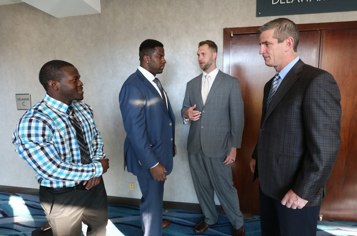 From left, Branden Oliver, Corbin Bryant, Scott Chandler and Frank Reich talk before attending The Call to Courage Award Breakfast. (James P. McCoy/Buffalo News)