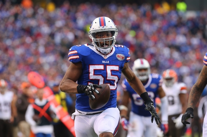 Buffalo Bills Jerry Hughes (55) scores a touchdown on a recovered fumble against the Cleveland Browns during the third quarter at Ralph Wilson Stadium, Nov. 30, 2014.  (Mark Mulville/Buffalo News)