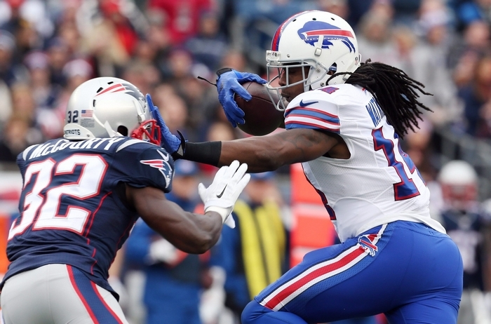 Buffalo Bills wide receiver Sammy Watkins (14) catches a pass and stiff-arms New England Patriots free safety Devin McCourty (32) for a first down in the Bills' season finale.  (James P. McCoy/Buffalo News)