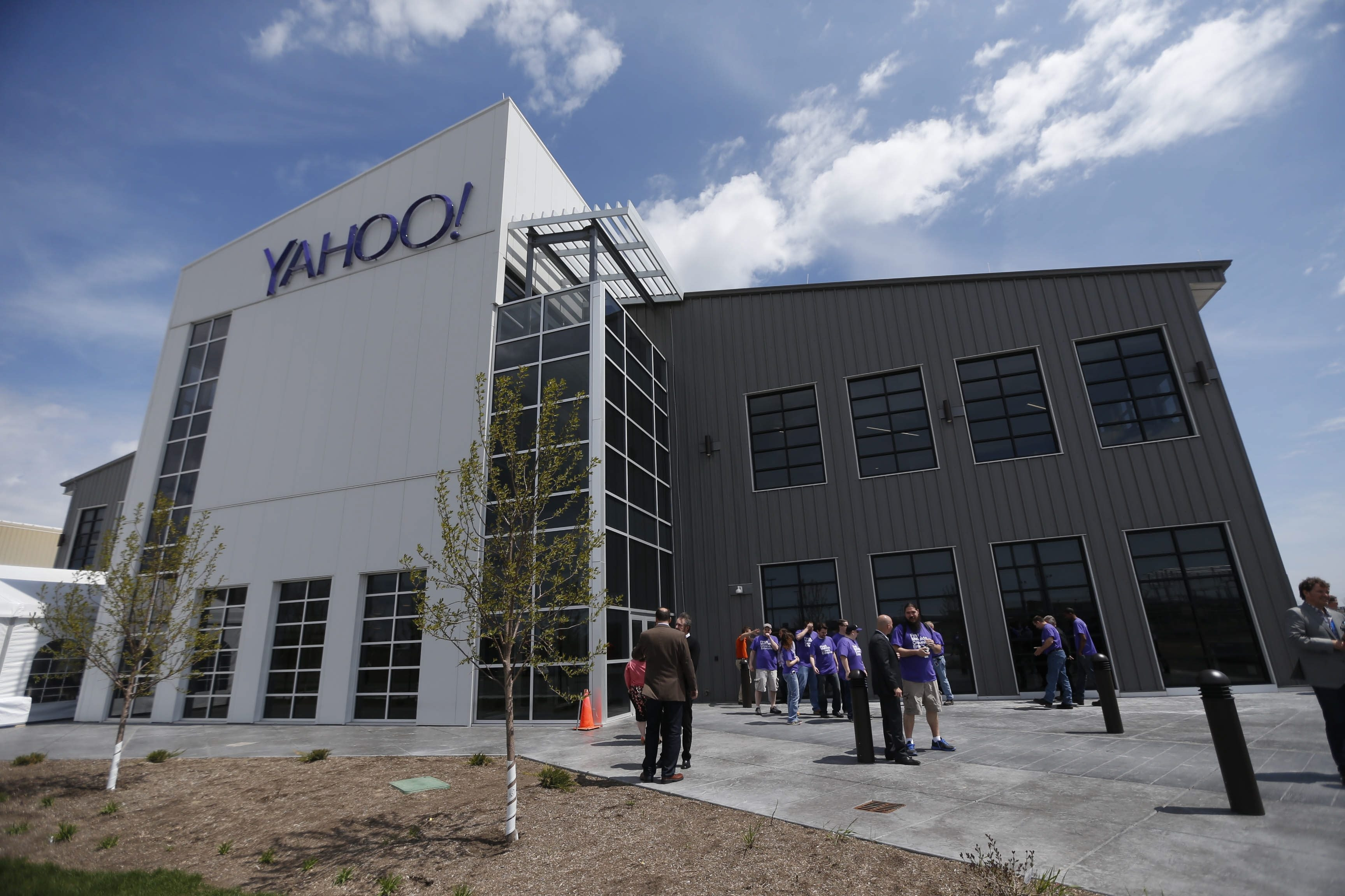 Yahoo employees gather outside the company's second data center and new customer call center on its Lockport campus for a grand opening celebration on Thursday. Yahoo has invested $170 million in its Lockport project so far.