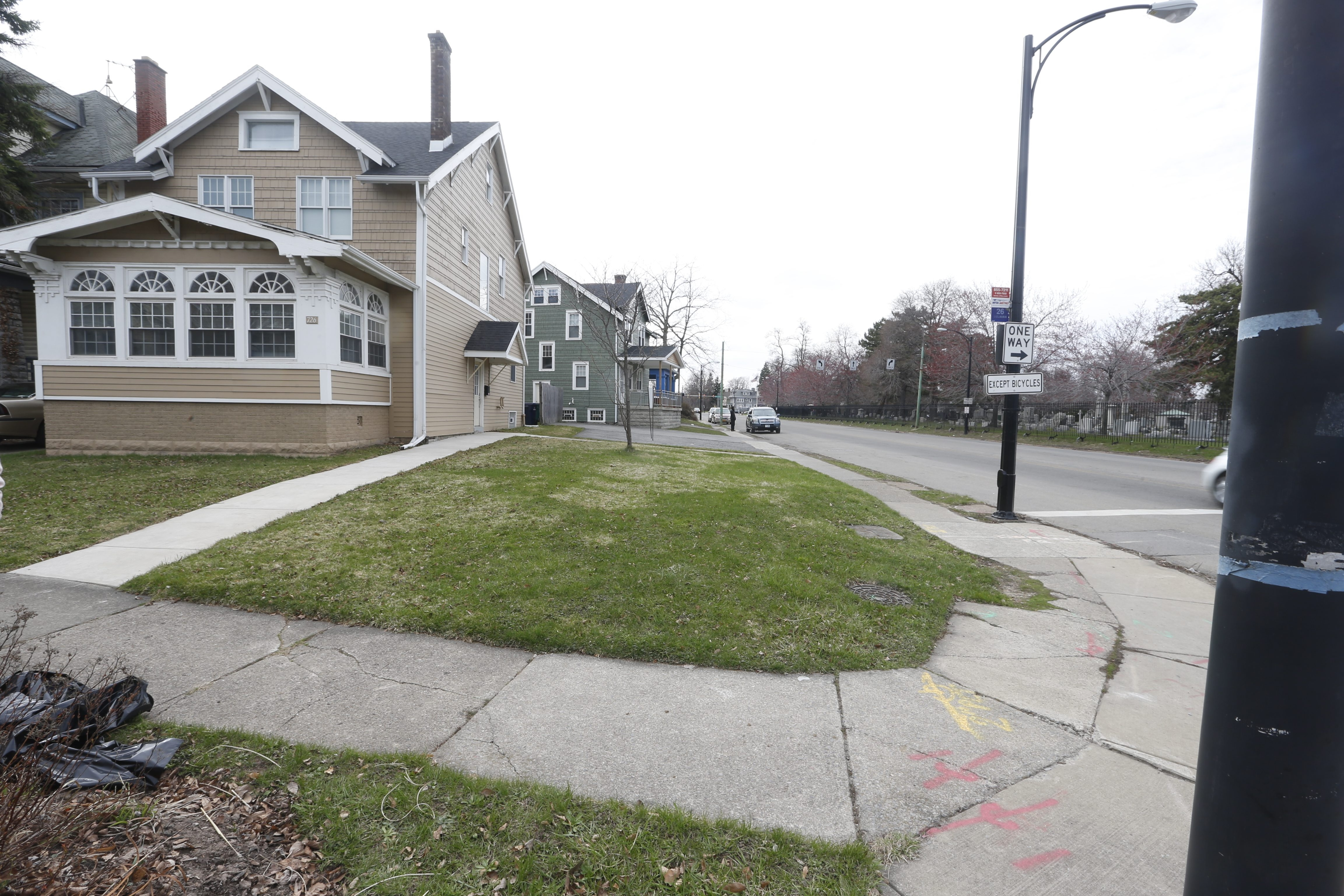 The lot next to Sandy Hodala's home 726 Linwood was recently purchased at a city auction, and purchaser wants to build a house on it.    (John Hickey/Buffalo News)