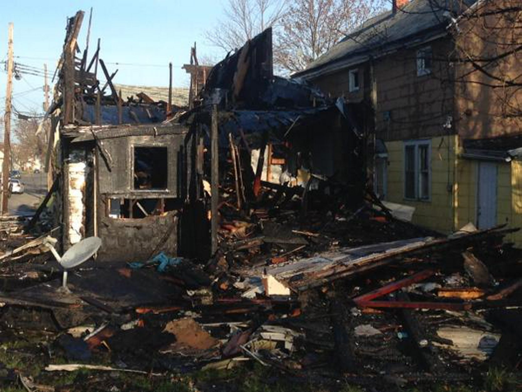 The vacant house on Deshler destroyed by fire Wednesday, April 29, 2015. (John Hickey/Buffalo News)