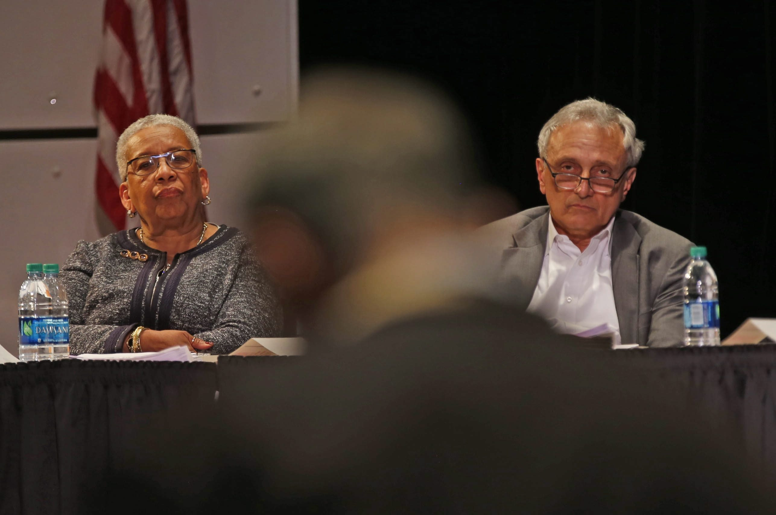 Buffalo School Board members Barbara Seals Nevergold and Carl Paladino listen to parent Mike Long as Long expresses dissatisfaction with the selection process for a new superintendent during the board's meeting Wednesday. At least 23 people addressed the board.