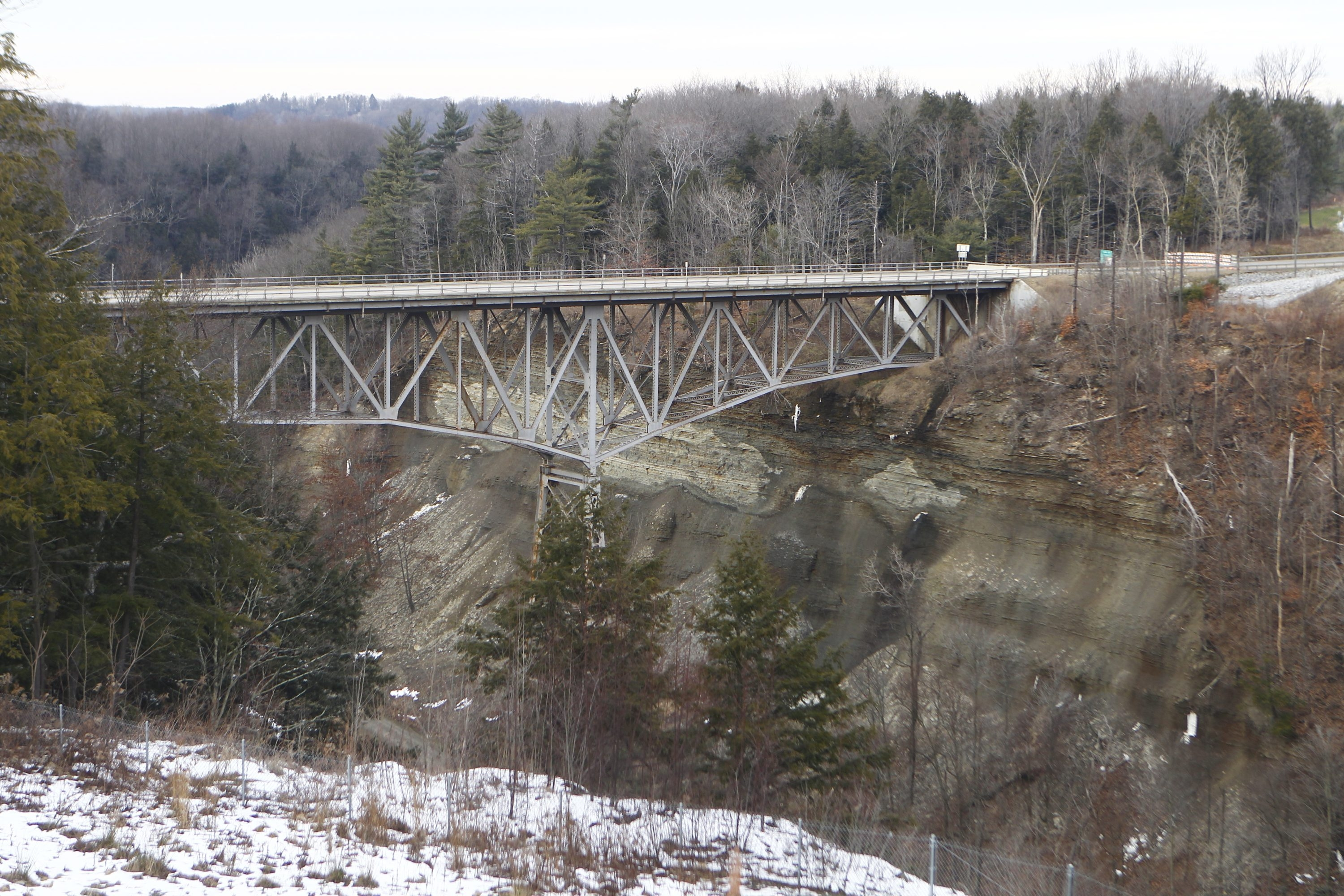 The  Old Route 219 bridge is closed in Springville. The nearby new Route 219 Expressway bride is now the state road serving the area.