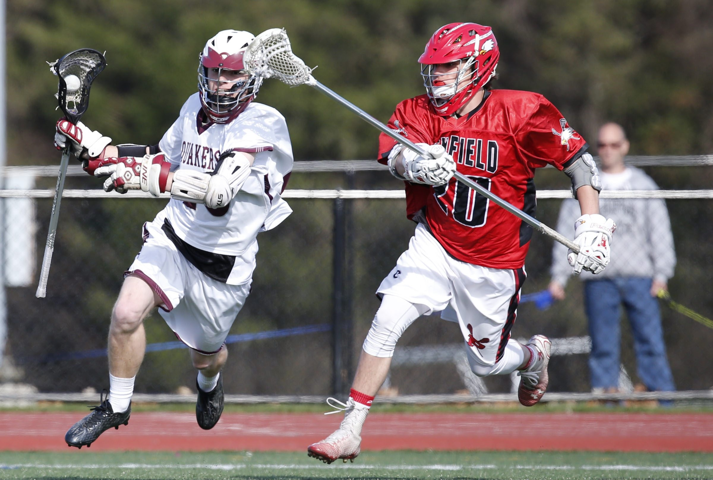 Orchard Park's Jack Crowley moves the ball upfield against Penfield during play in Thursday's game. The Quakers earned the 11-7 win.