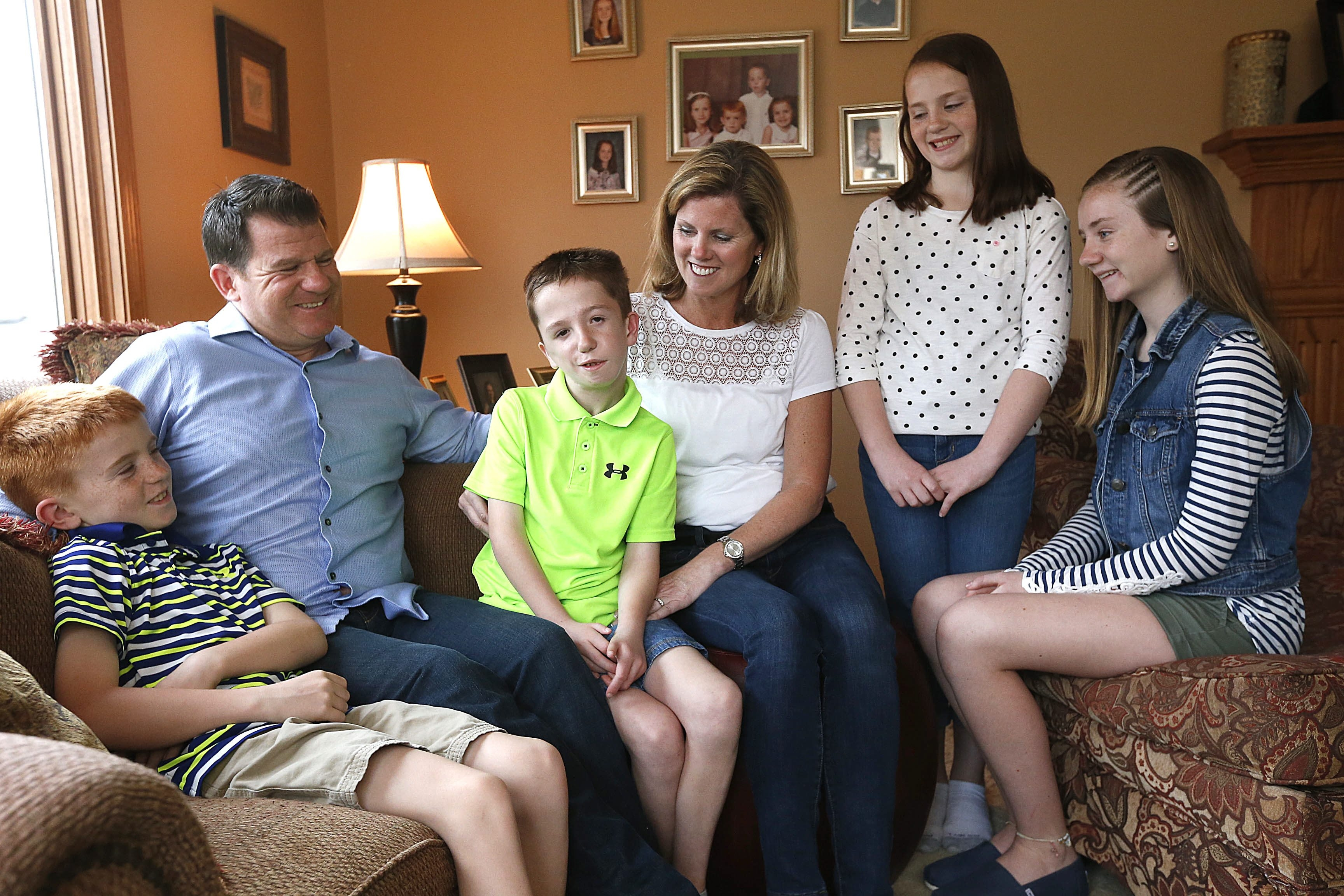 Colleen and Vincent Vanderlip at their West Seneca home with their four children, from left, Ryan, 9, Conor, 11, Grace, 11, and Madison, 14.