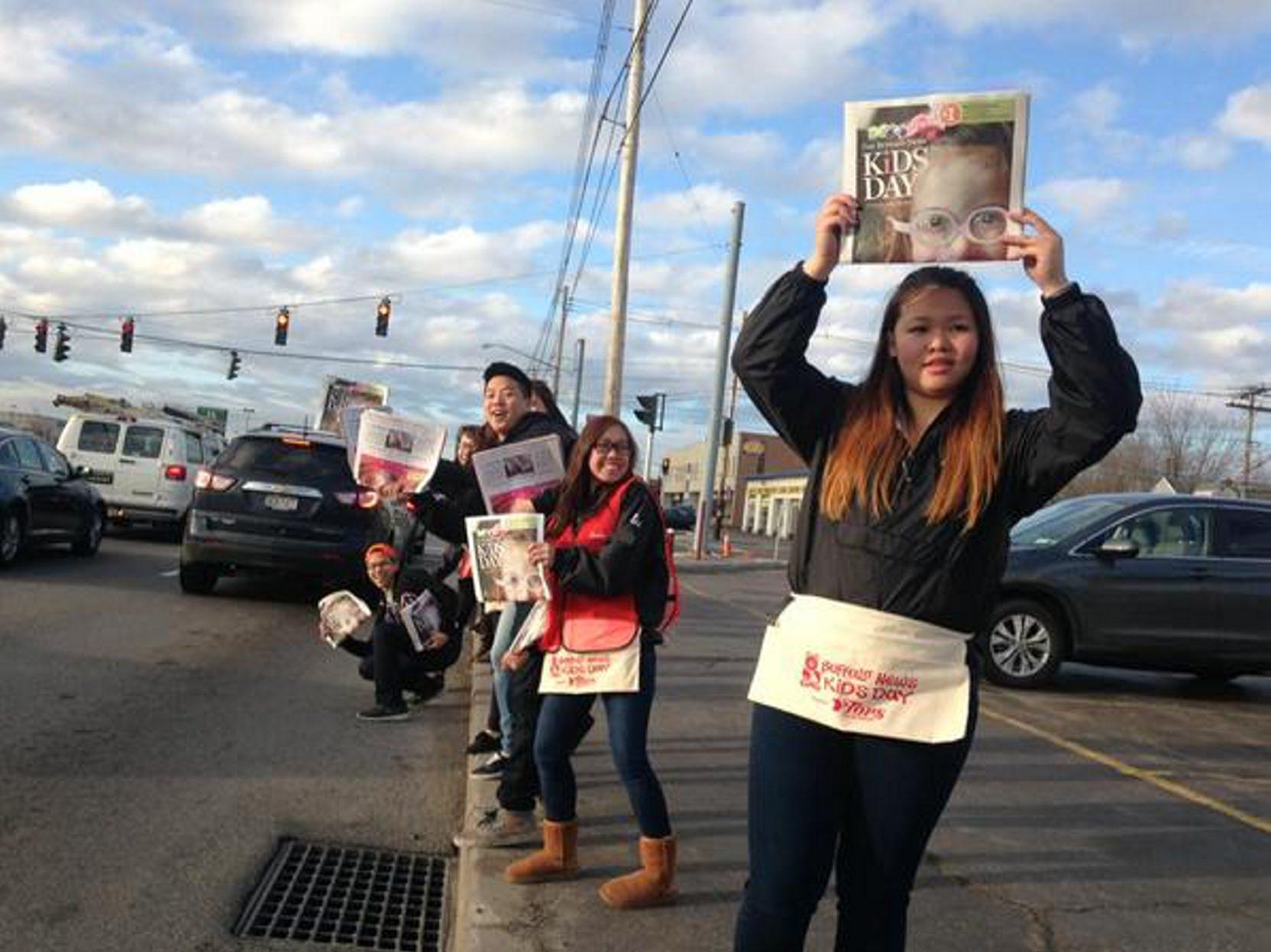 Susan Su, a member of Alpha Kappa Delta Phi, helps sell Kids Day special editions of The Buffalo News April 28, 2015. (John Hickey/Buffalo News)