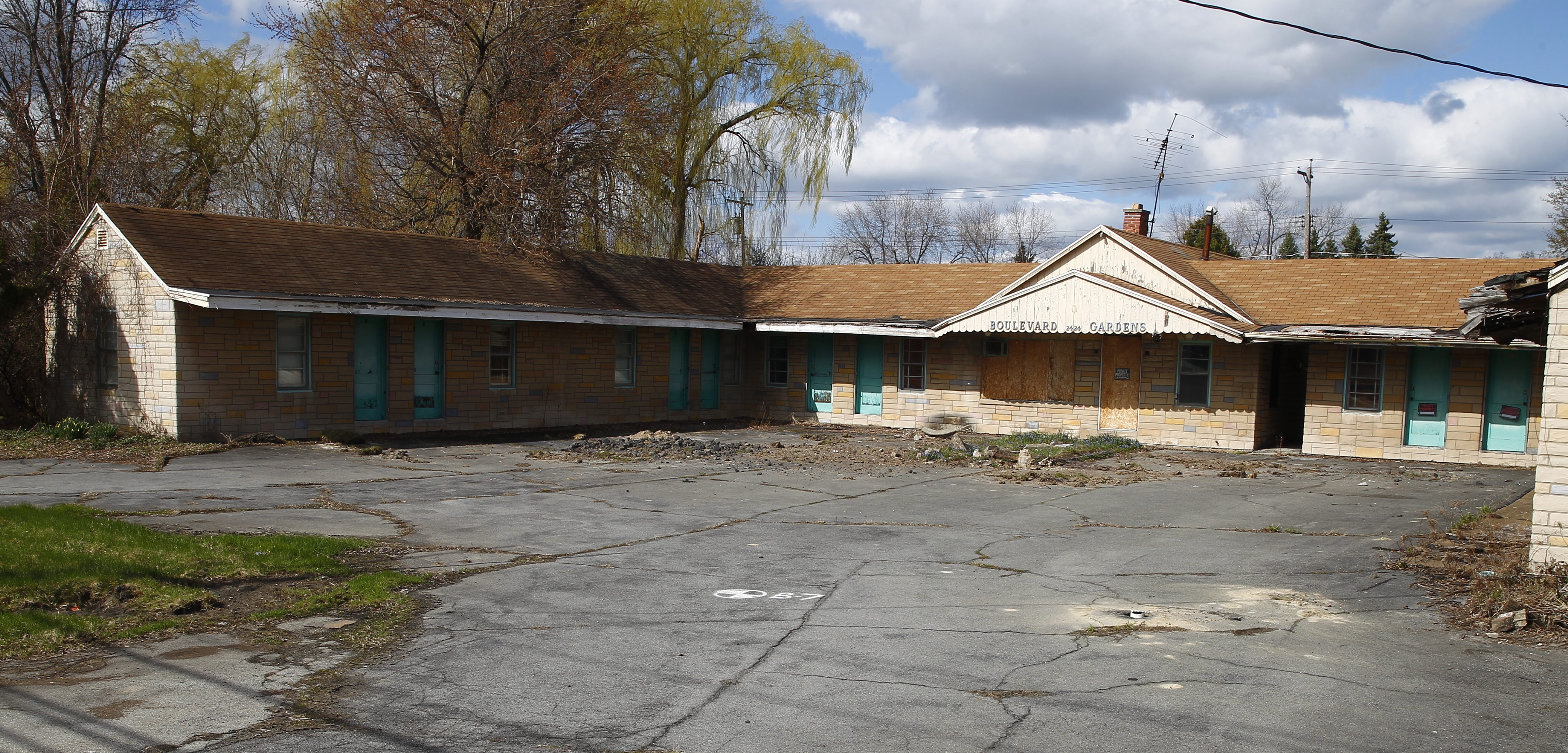 Plans for a Holiday Inn Express on Niagara Falls Boulevard, between Forbes and Thistle Avenues, were proposed more than two years ago the properties still remain fenced in waiting for development in  Town of Tonawanda, NY on Friday, April 24, 2015.  (John Hickey/Buffalo News)