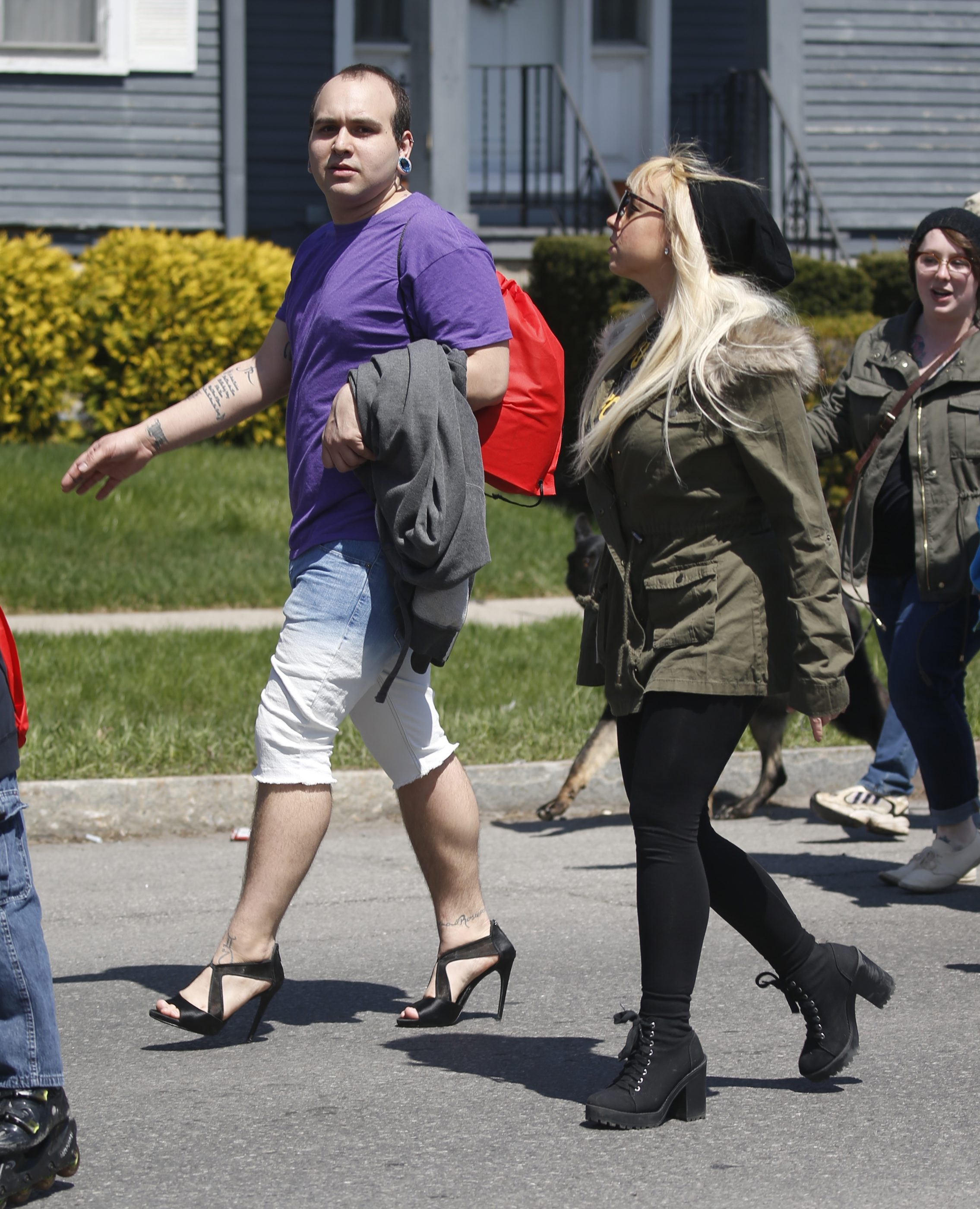 Nolan Arroyo, joined by Megan Rose, marches in high heels down  during Walk A Mile In Her Shoes to spotlight problems of domestic and sexual violence. See a photo gallery at buffalonews.com.
