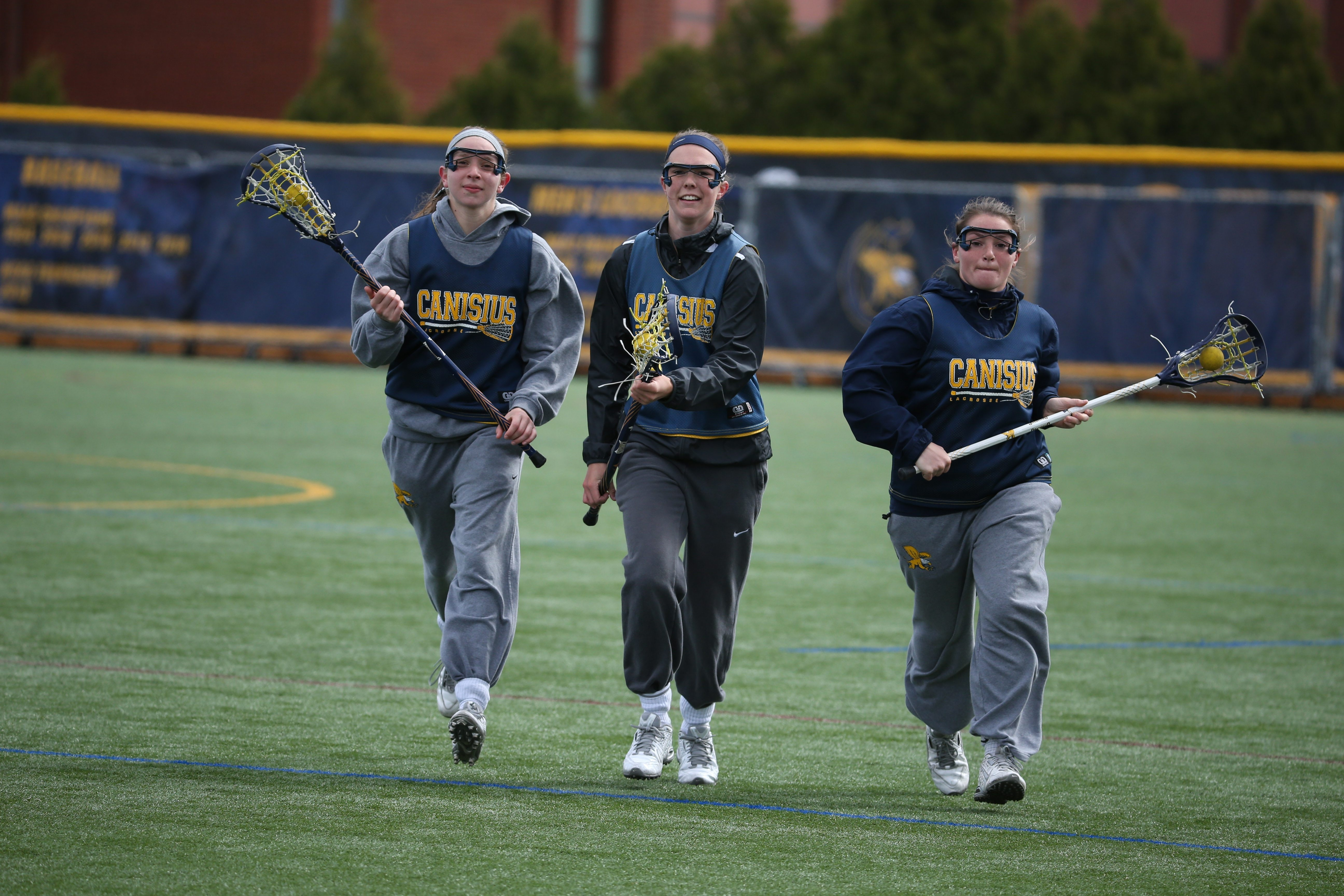 Canisius women's lacrosse players (left to right) Tori Greco, Erica Evans and Tori Quinn are gearing up for another MAAC Tournament.
