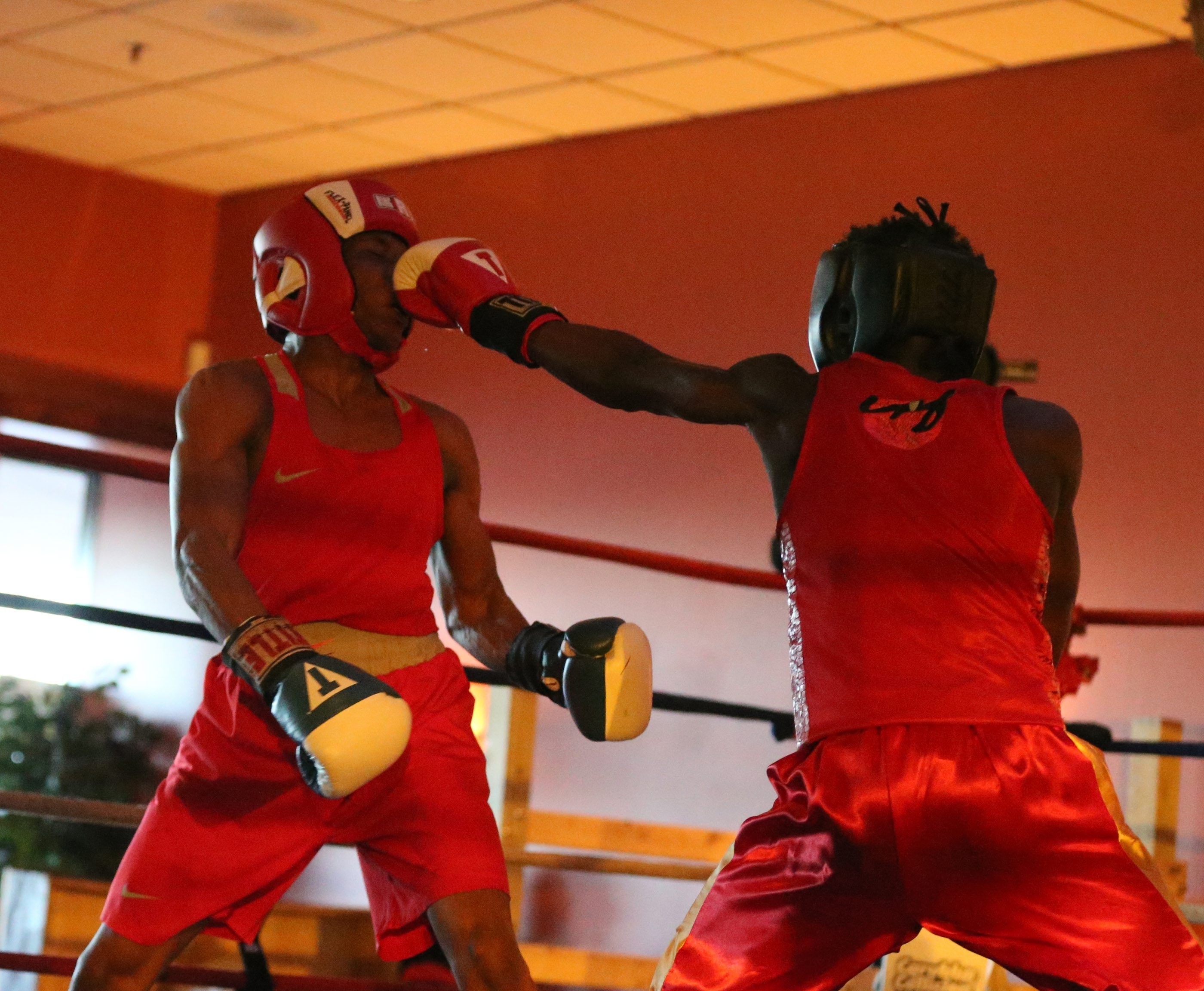 James P. McCoy/Buffalo NewsSequan Felton of St. Martin's Boxing in Rochester, right, absorbs a hard shot from Jeffery Ngyout of Buffalo's Westside Boxing Club in the 132-pound open bout at the New York State Golden Gloves championships.