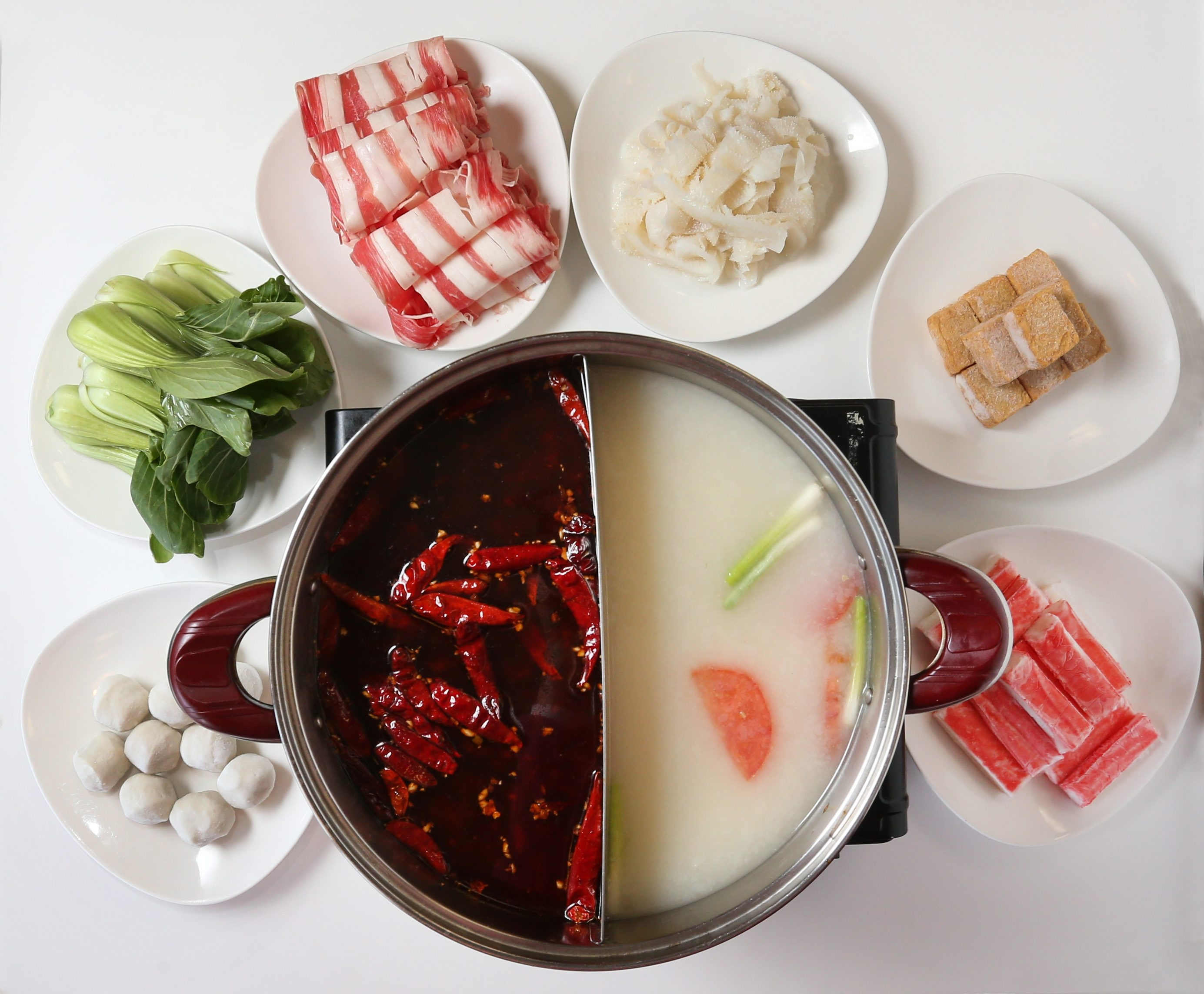 China Star restaurant is at 4001 Sheridan Drive in Amherst.  This is the Chong Qing Hot Pot.  It's served family style and diners cook their dinners in the boiling soups. Photo taken, Tuesday, April 21, 2015.  (Sharon Cantillon/Buffalo News)