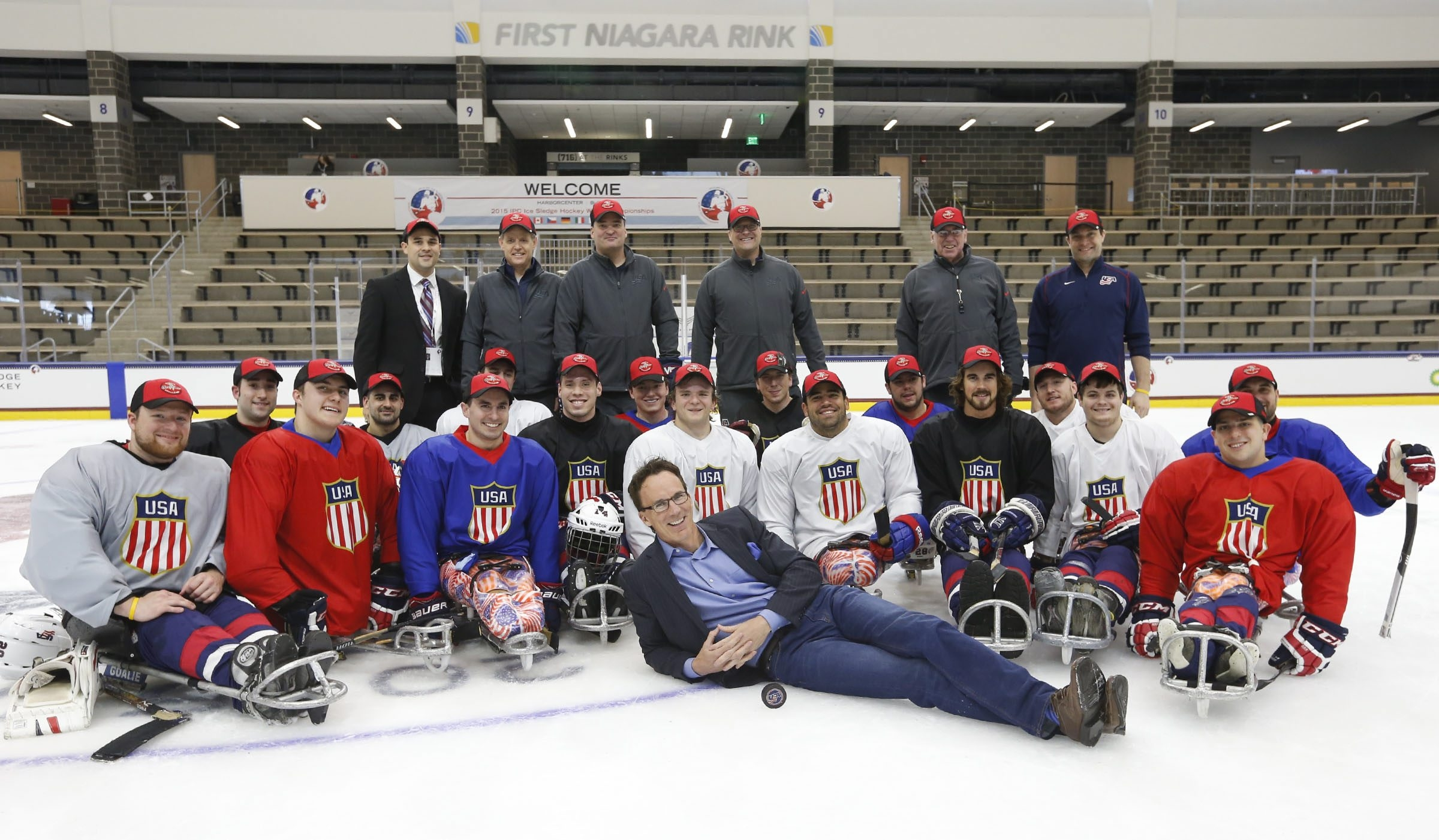 ESPN's John Buccigross meets with Team USA players after practice for the upcoming IPC Sledge Hockey World Championships.