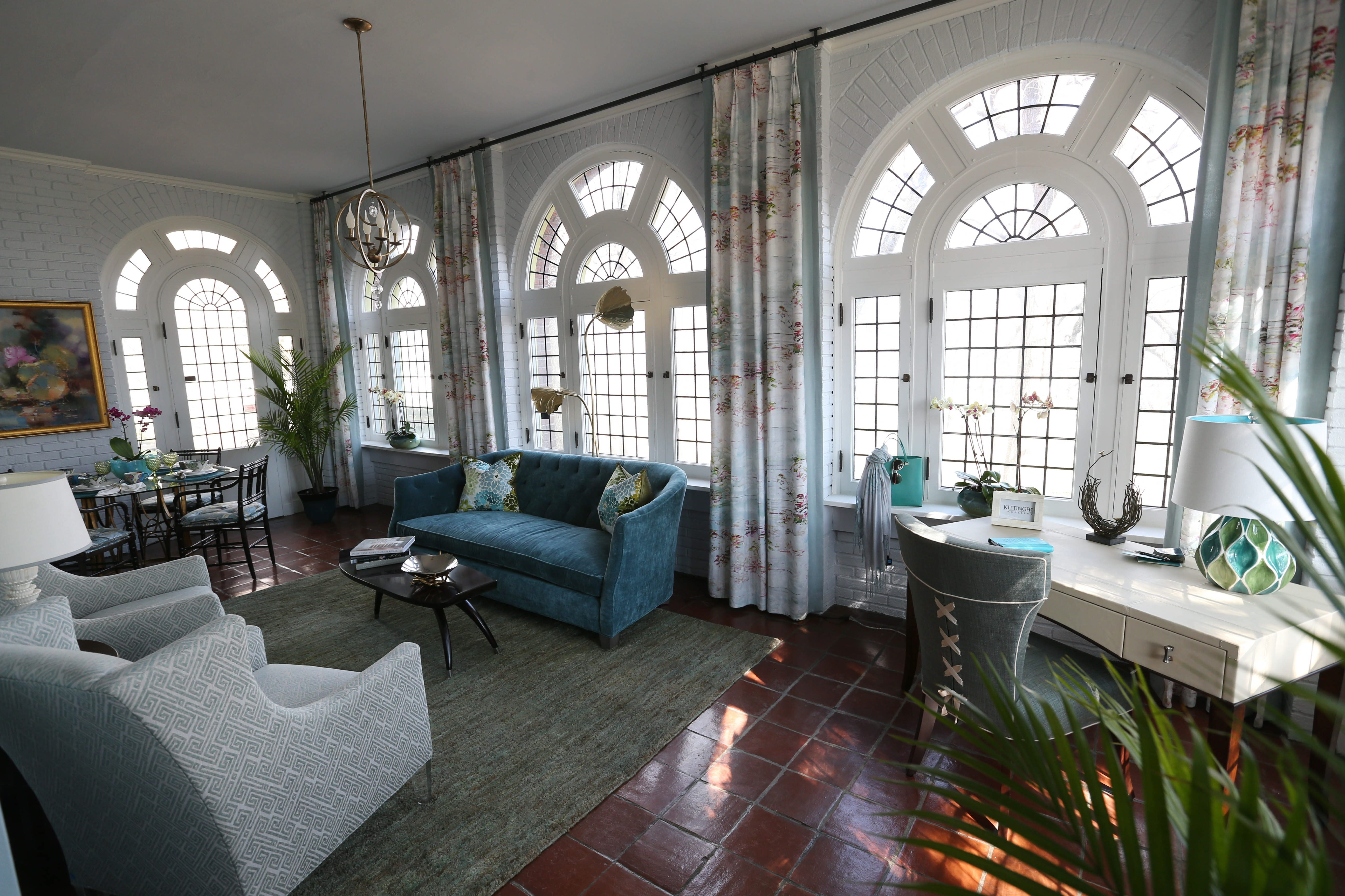 "Tour time: The 2015 Decorators' Show House features more than 40 decorated spaces in the main house, carriage house and on the grounds. Natural light adds to the tranquil feel of ""Monet's Sanctuary,"" above, a multipurpose day room in the main house designed by Kittinger Gallery and Design Studio. Below, a ""before"" photo of the room taken in January. Bottom of page, the master bedroom (Mark Taylor Interiors) and ""Linked in Royal"" master bath (Visionary Baths & More)."