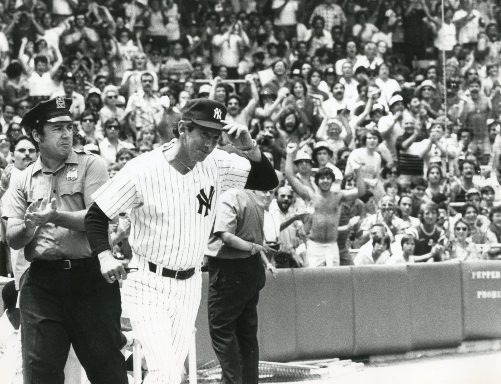 Billy Martin acknowledges fans' cheers as he joins teammates for 1978 Old Timers' Game at Yankee Stadium.