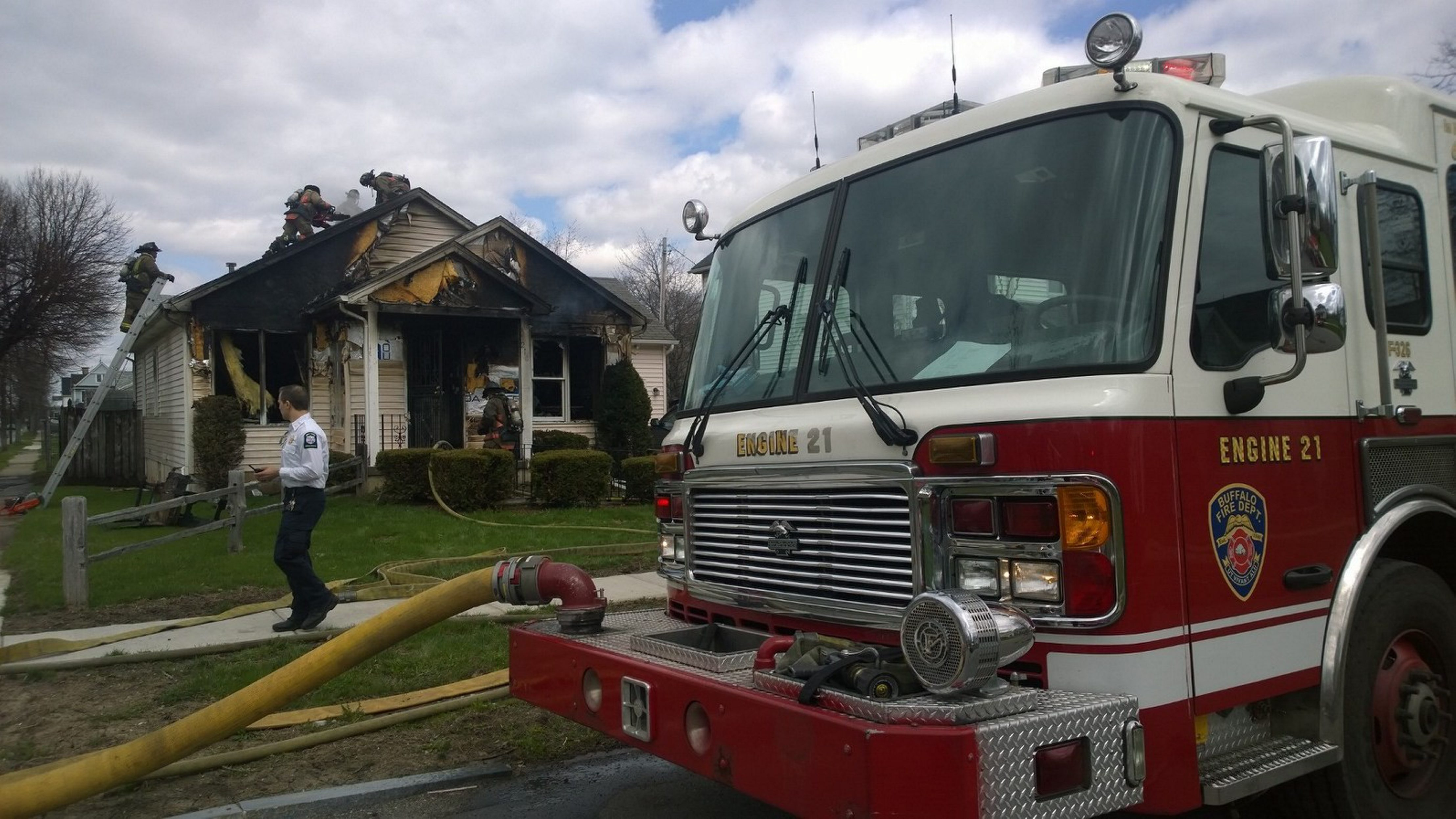 Buffalo firefighters battled fires in a house and garage on Glenwood Avenue Friday afternoon. The blaze left the front of the one-story house severely charred and the inside appeared to be heavily damaged. Firefighters remained at the scene for hours examining debris.