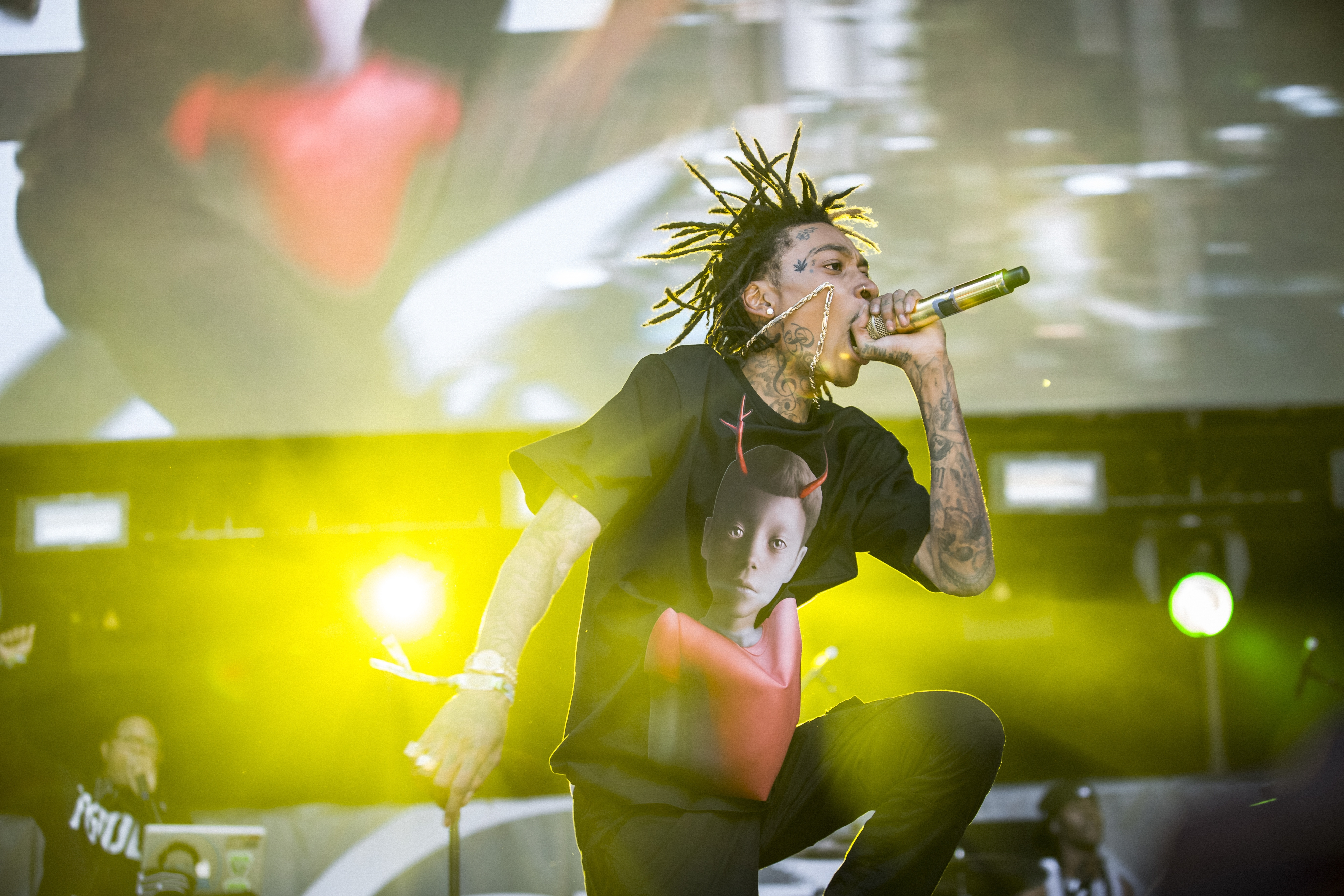Wiz Khalifa performs during the Hot 97's Summer Jam at the MetLife Stadium in East Rutherford, N.J., June 1, 2014. As hip-hop has become less tense and less overtly confrontational, the Summer Jam has had to find new traditions, new believers in the old ones, or accept that the Jam can't be what it once was. (Chad Batka/The New York Times)