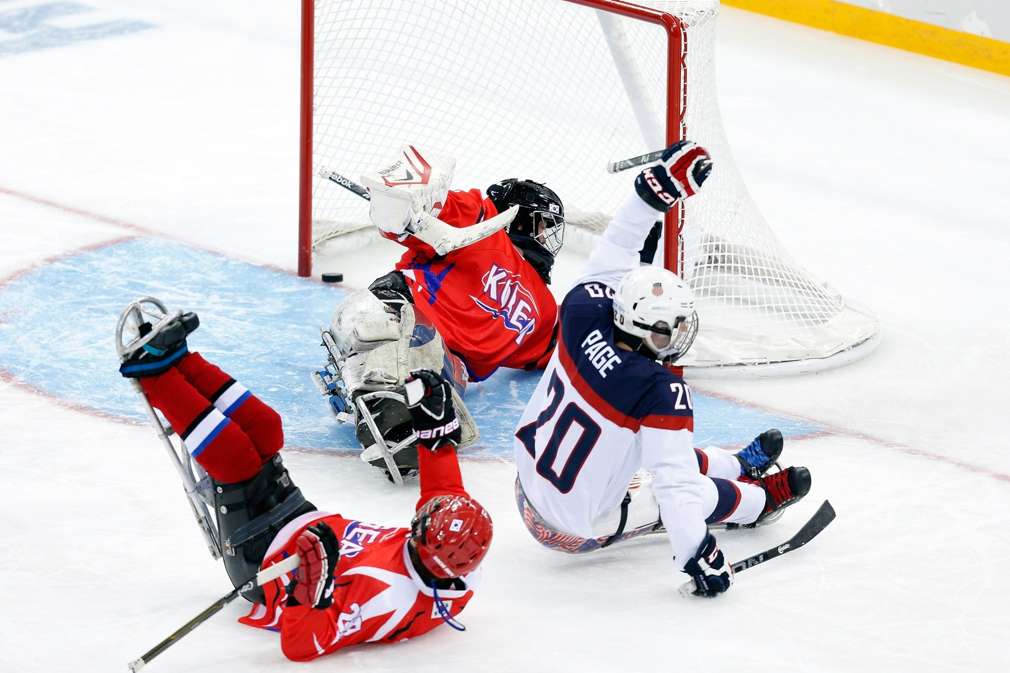 Adam Page of Lancaster, scoring against Korea in a 2014 game, will be playing in his fifth Sledge Hockey World Championships.
