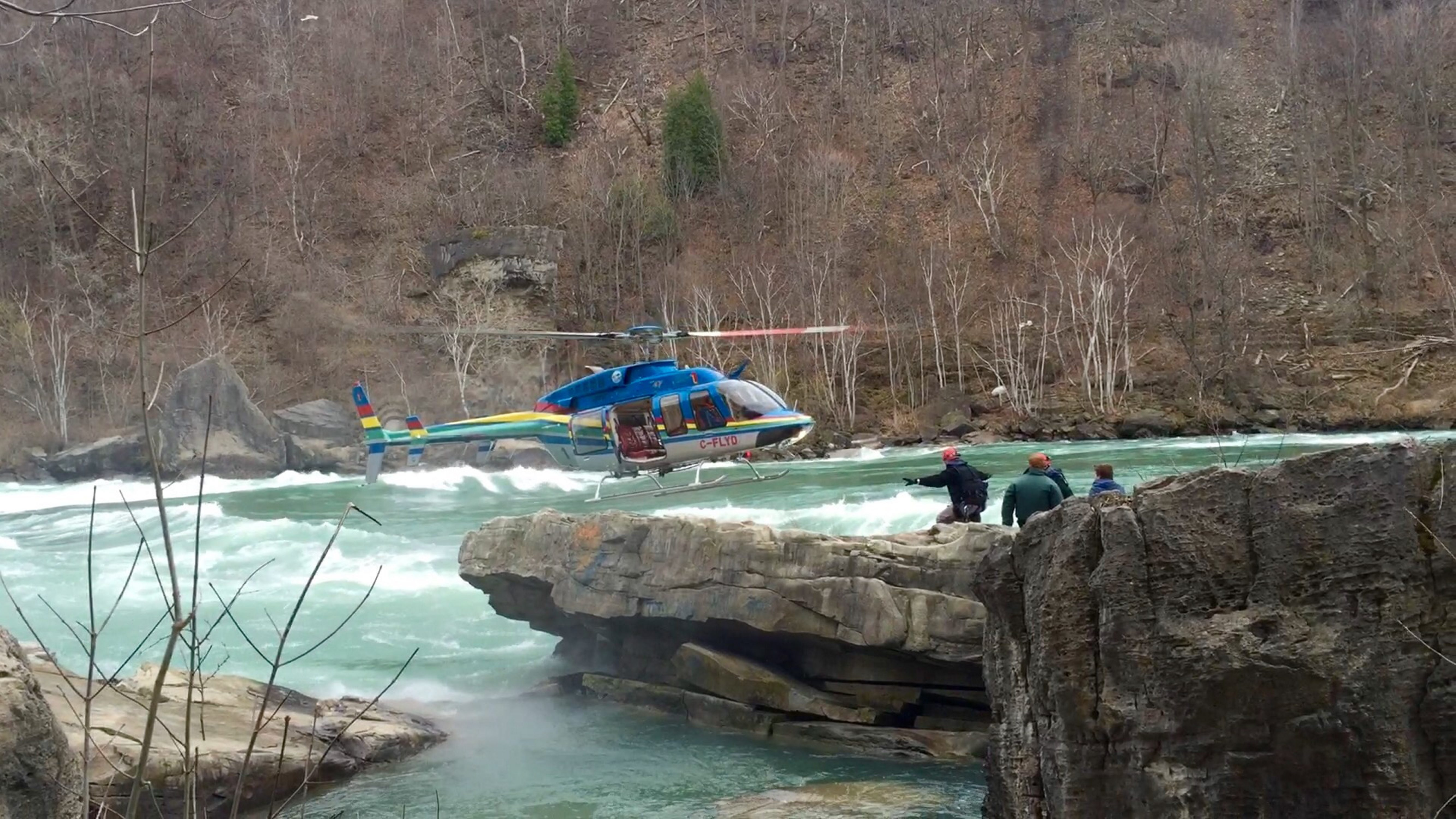 A helicopter provided by Niagara Helicopters rescues two stranded fishermen April 22 in the Niagara River gorge. (Niagara Parks Police)