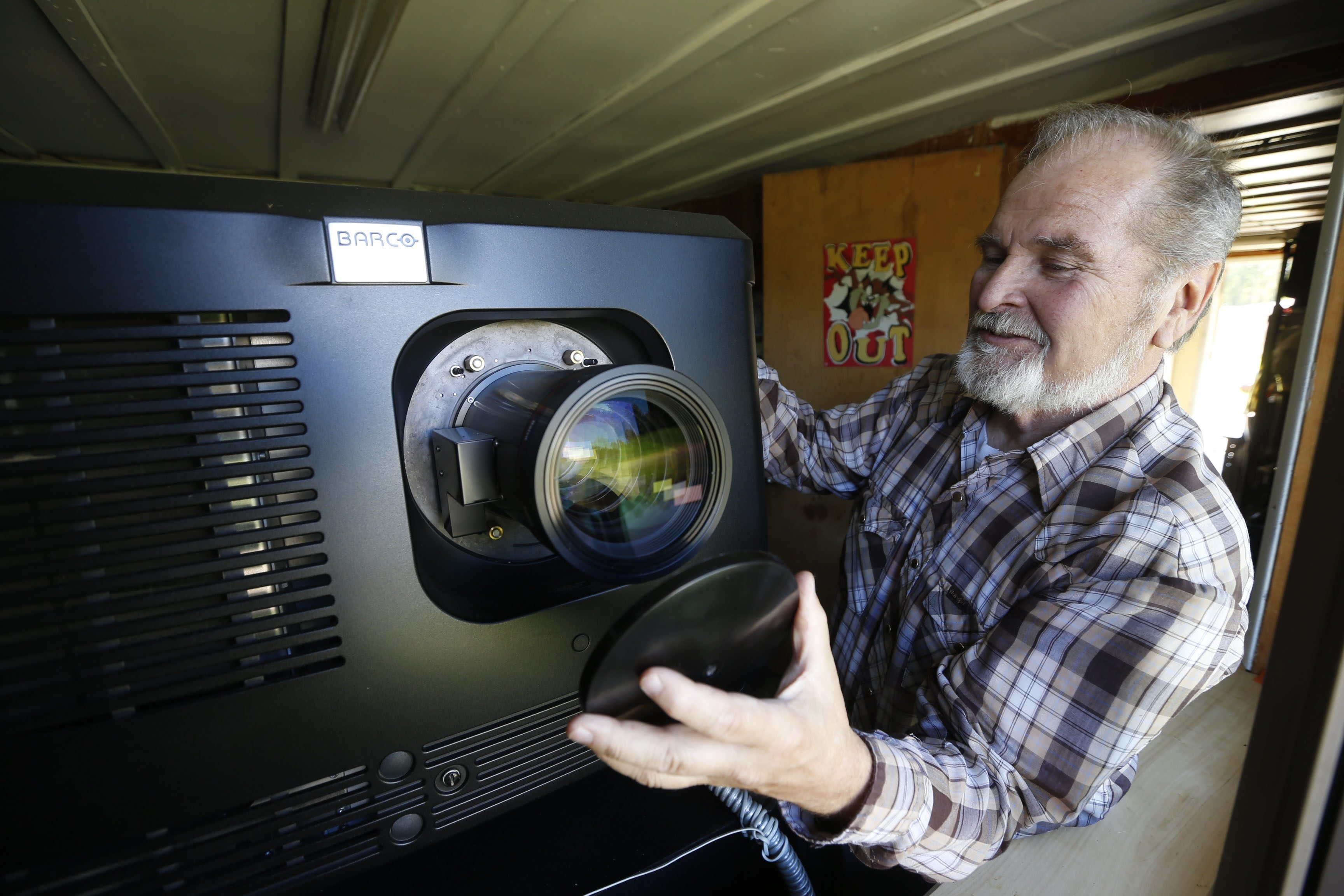 A News file photo shows Don Loomis adjusting his new $68,000 digital projector last fall at the Loomis Delevan Drive-In, which now has a new owner, Dr. Michael DiBella who has renamed it the Twin Delevan Drive-In.  (Robert Kirkham/Buffalo News)