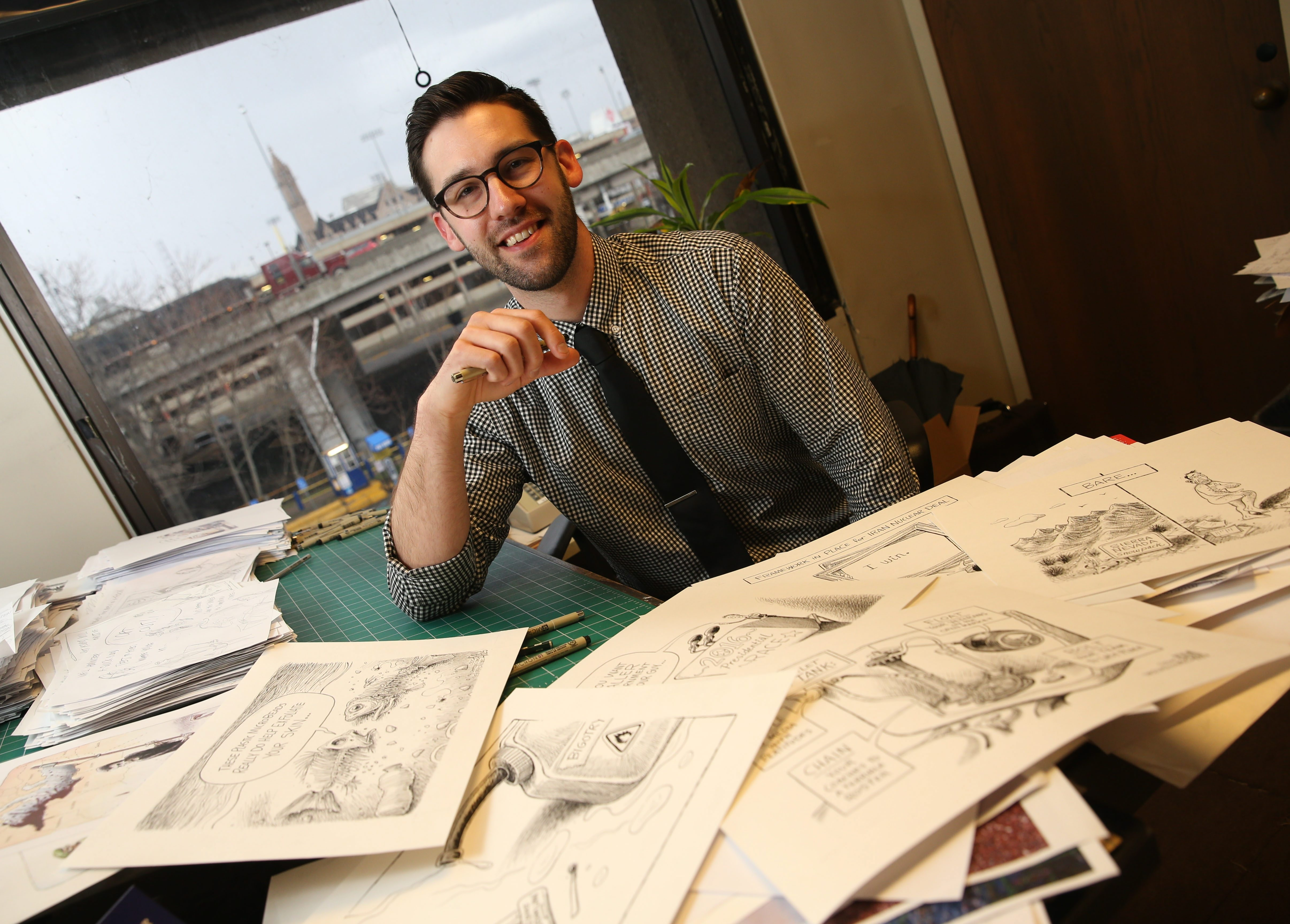 'Without an awesome team and an awesome newsroom, and a city that cares, I couldn't flourish,' said News editorial cartoonist Adam Zyglis, who won the Pulitzer Prize.