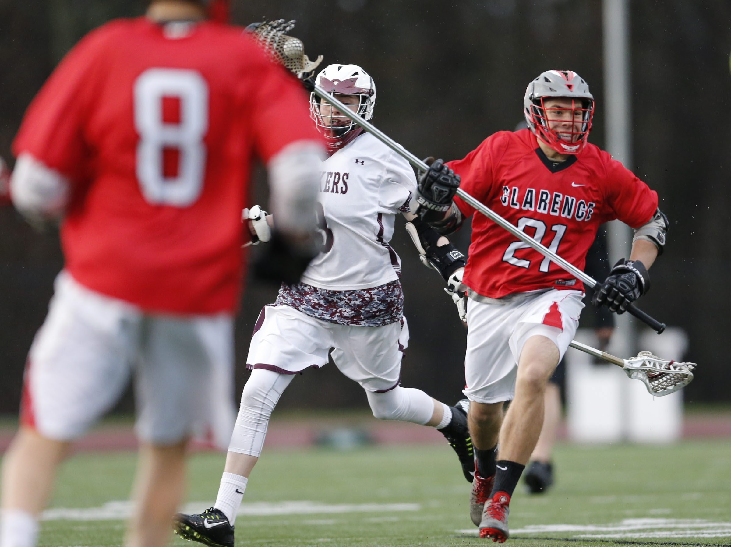 Clarence defenseman Spencer Irving heads upfield during a 13-9 victory over host Orchard Park in a Class A lacrosse matchup Monday.