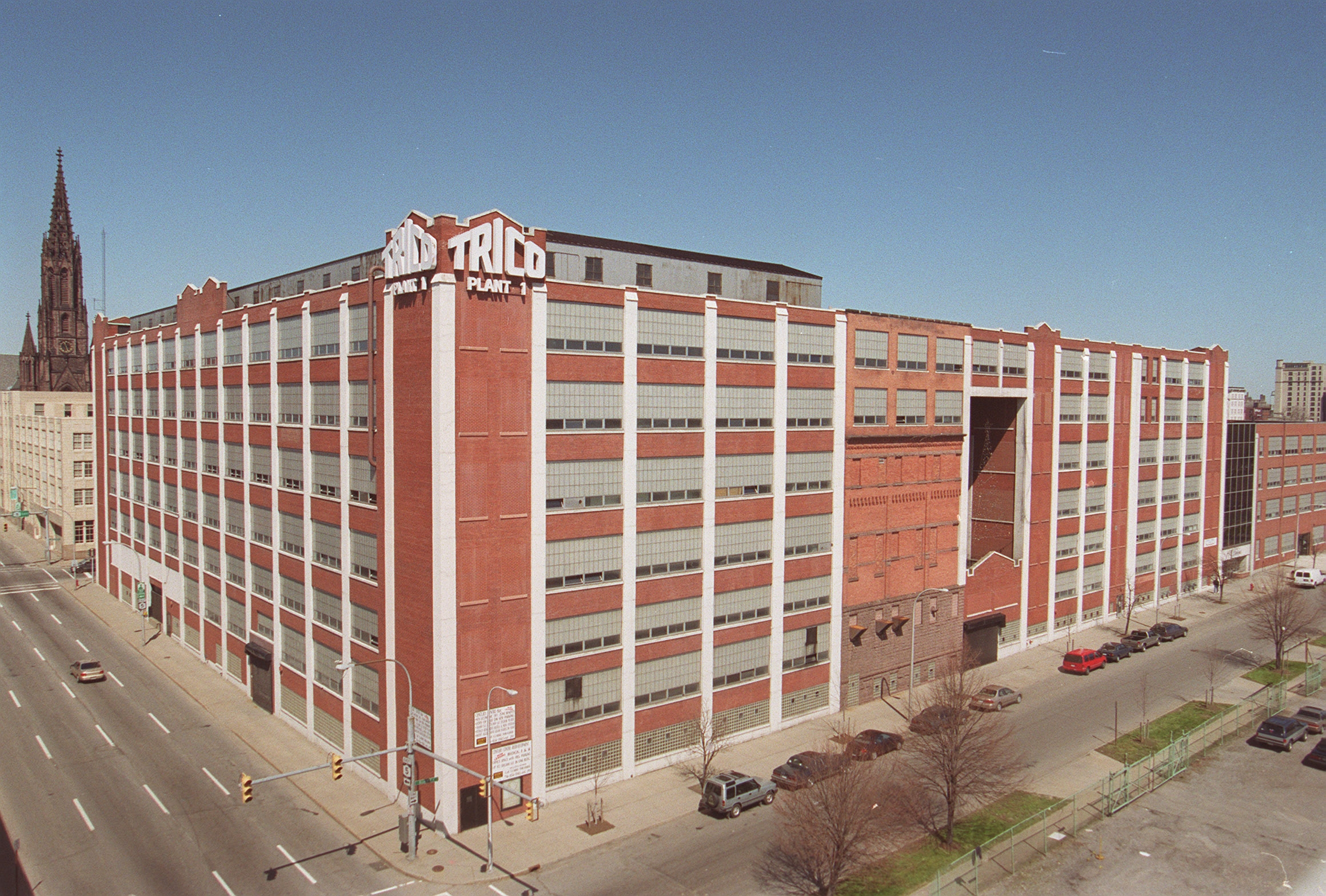 Under Krog Corp.'s plan, the former Trico Products Corp. warehouse on Goodell Street would become a mixed-use facility featuring hotel rooms, apartments and office space.