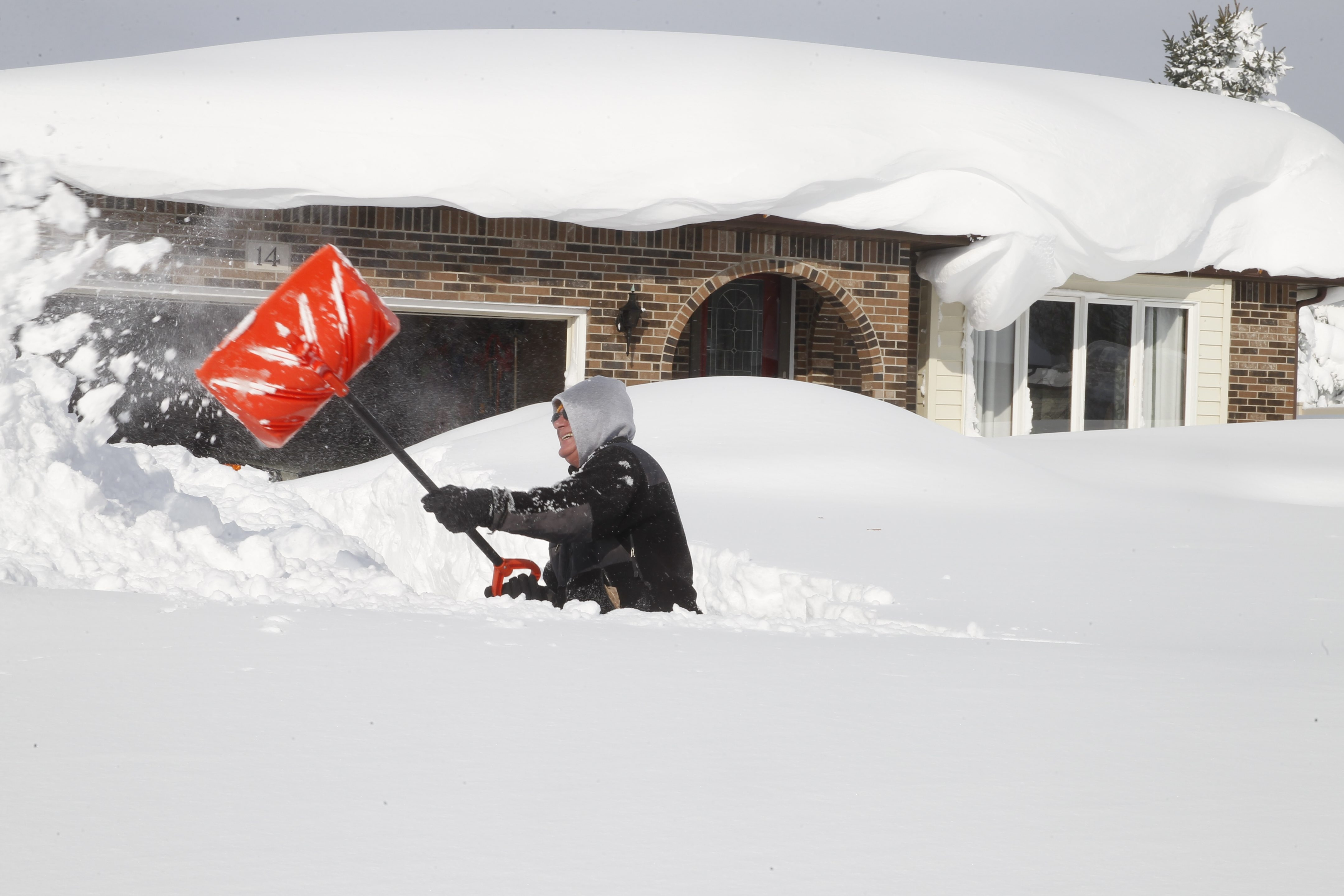 Dan Galinski shovels out on Hillpine Road  in Cheektowaga, N.Y. , as Lake effect storm impacts  Lancaster, Cheektowaga , Buffalo and south towns for second day, on Wednesday  November  19, 2014. .(John Hickey/Buffalo News)
