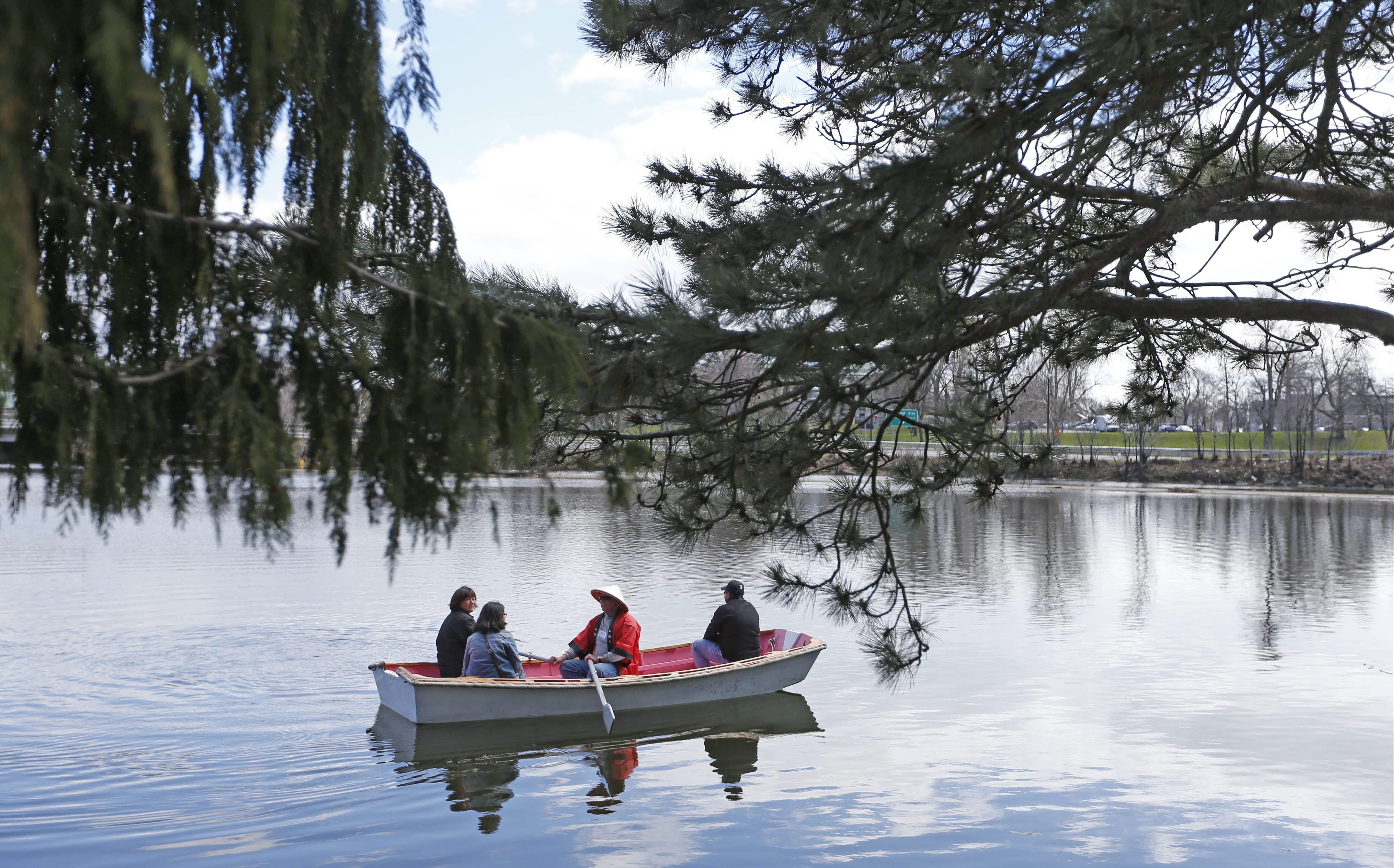 Eager for spring, passengers enjoyed a boat ride on the lake outside the Buffalo History Museum and Japanese Garden during last year's Cherry Blossom Festival in Buffalo.  (Robert Kirkham/Buffalo News)