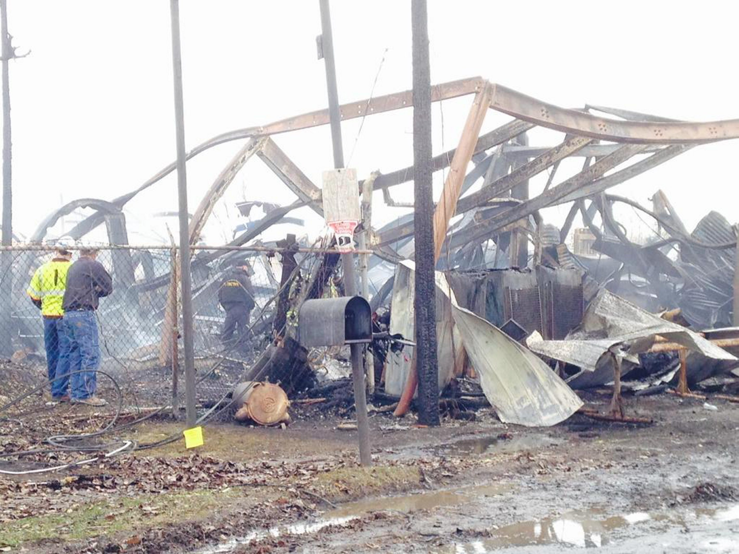 Fire crews and investigators sift throughout the rubble at Placid Harbor Marina in North Tonawanda after a blaze reported at 2:35 a.m. Monday ripped through the 2½-story steel and concrete facility, causing significant damage.