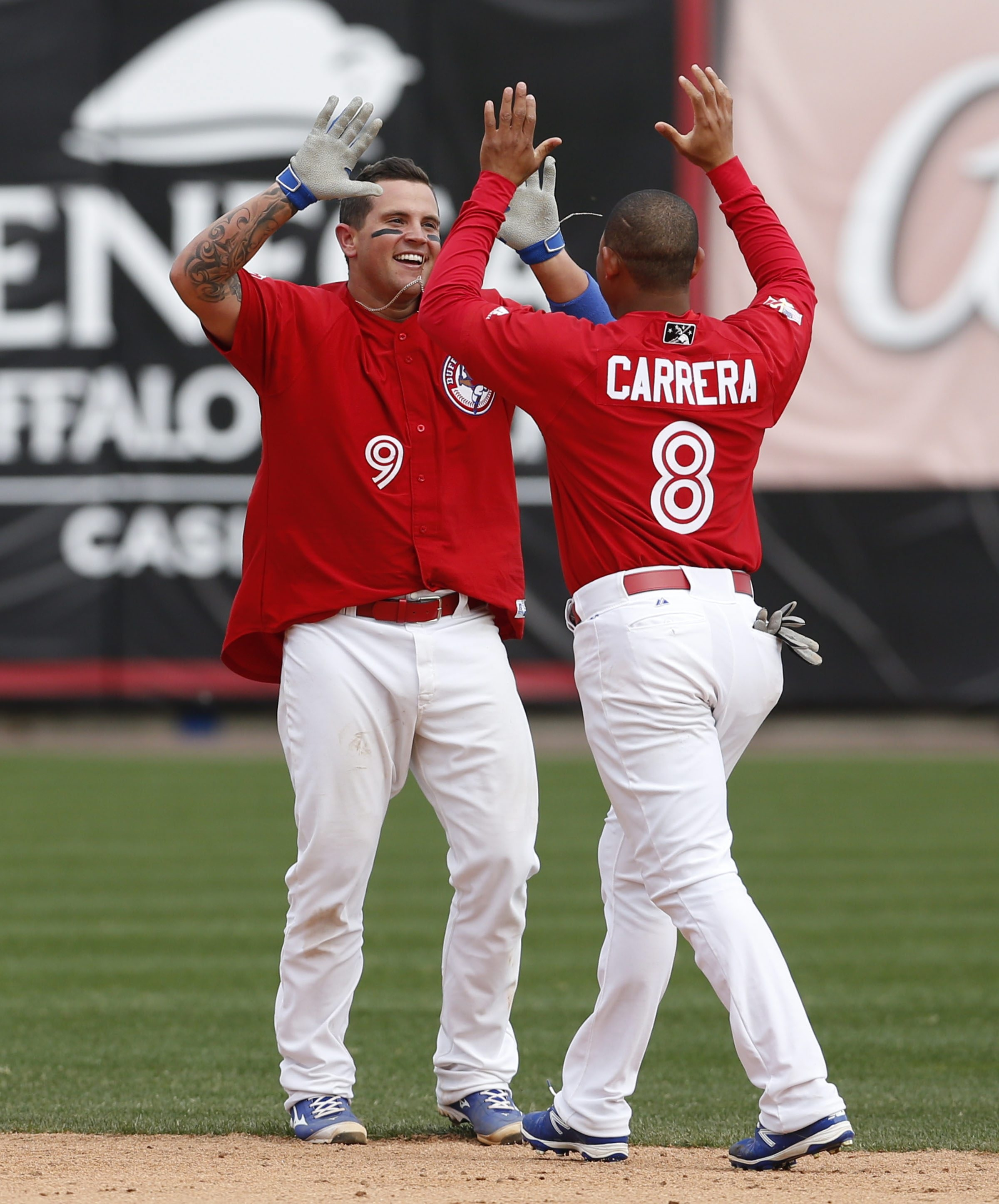 Ezequiel Carrera congratulates Sean Ochinko on his game-winner.