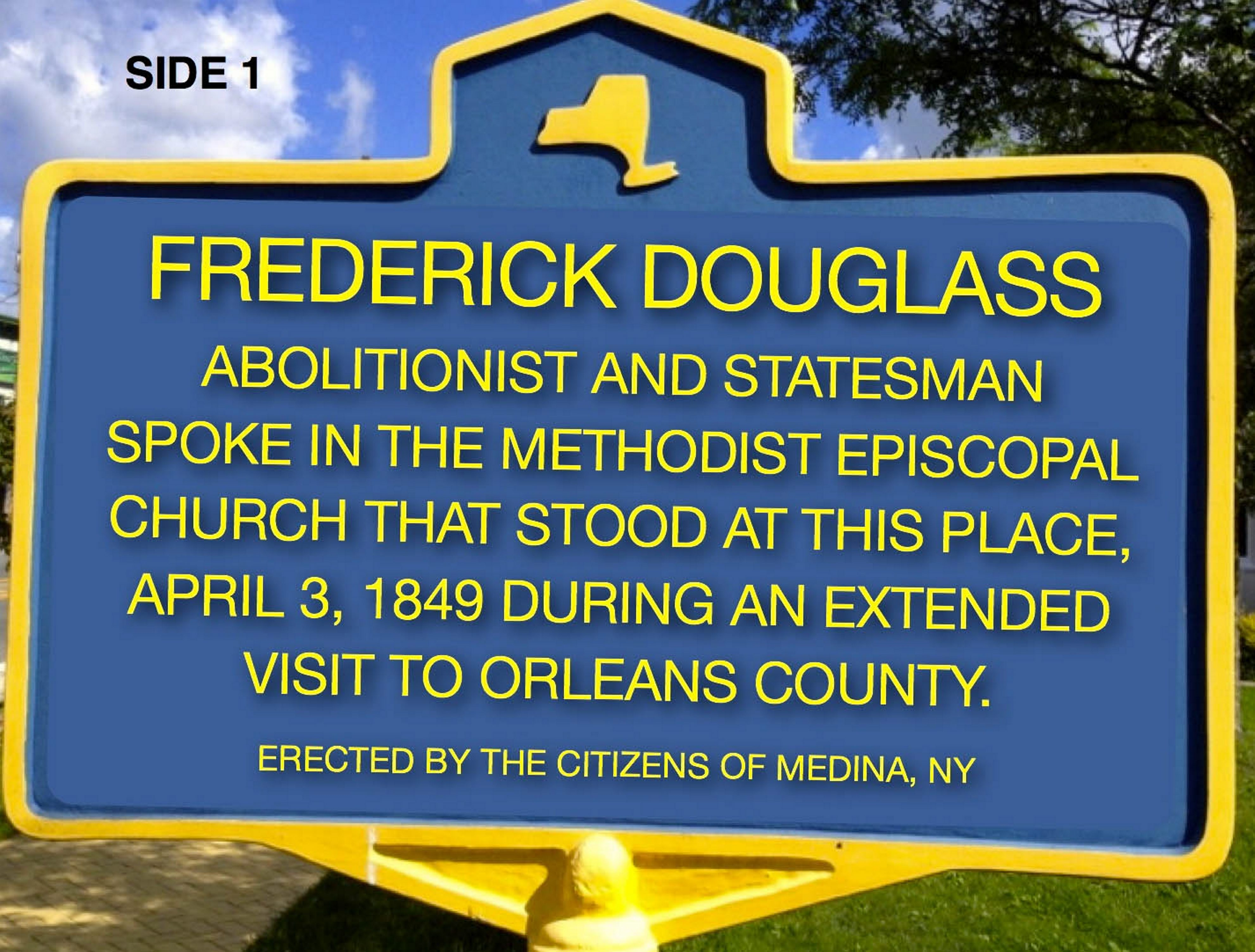 One side of the state historical marker honoring 19th-century African-American leader Frederick Douglass that will be dedi- cated in a ceremony at 9 a.m. Friday on the Main Street site in Medina where the famed abolitionist and statesman once spoke.