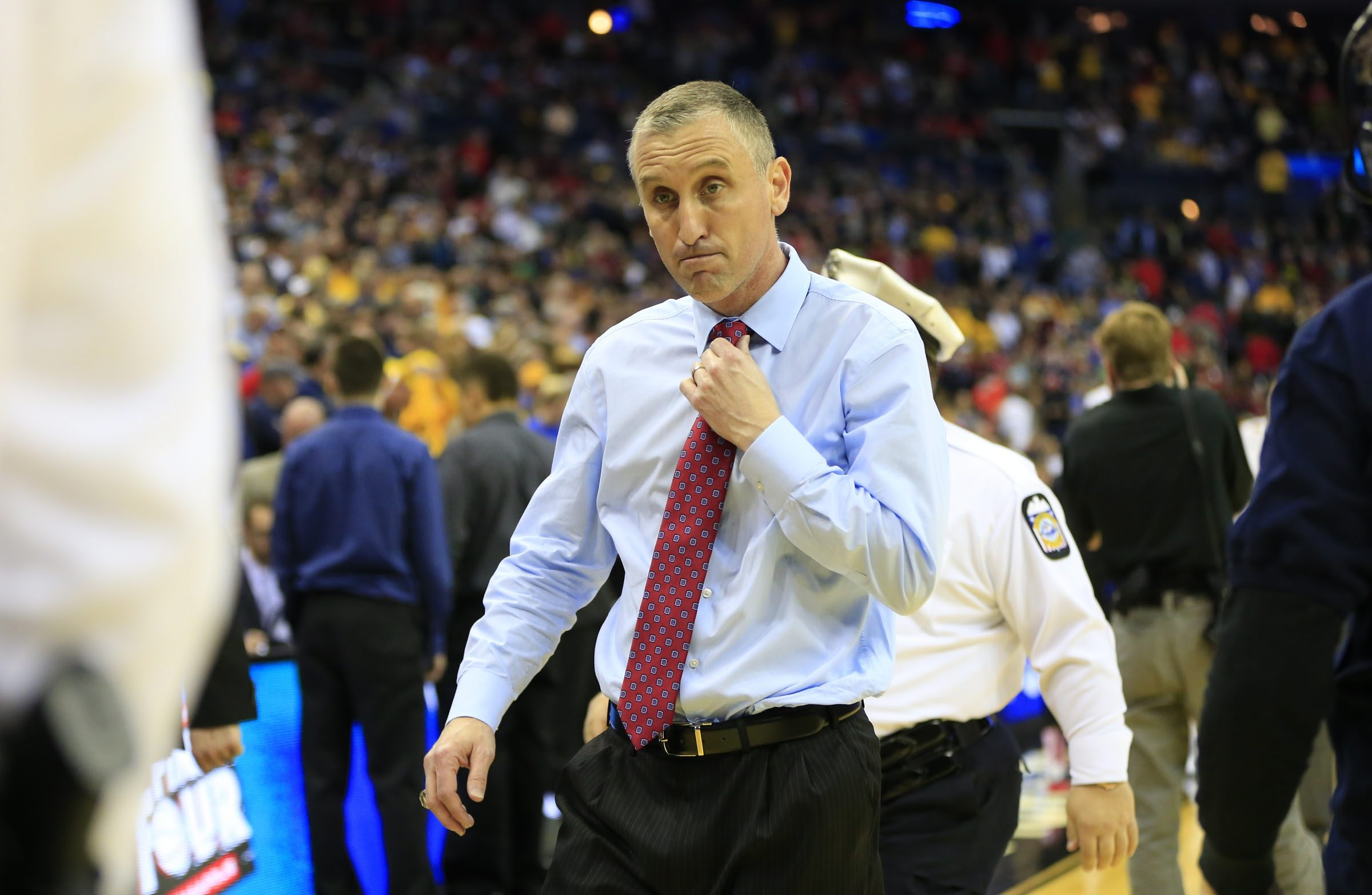 University at Buffalo basketball coach Bobby Hurley walks off the court after his team lost to West Virginia in the NCAA tournament in Columbus, Ohio, on March 20. (Harry Scull Jr./Buffalo News)