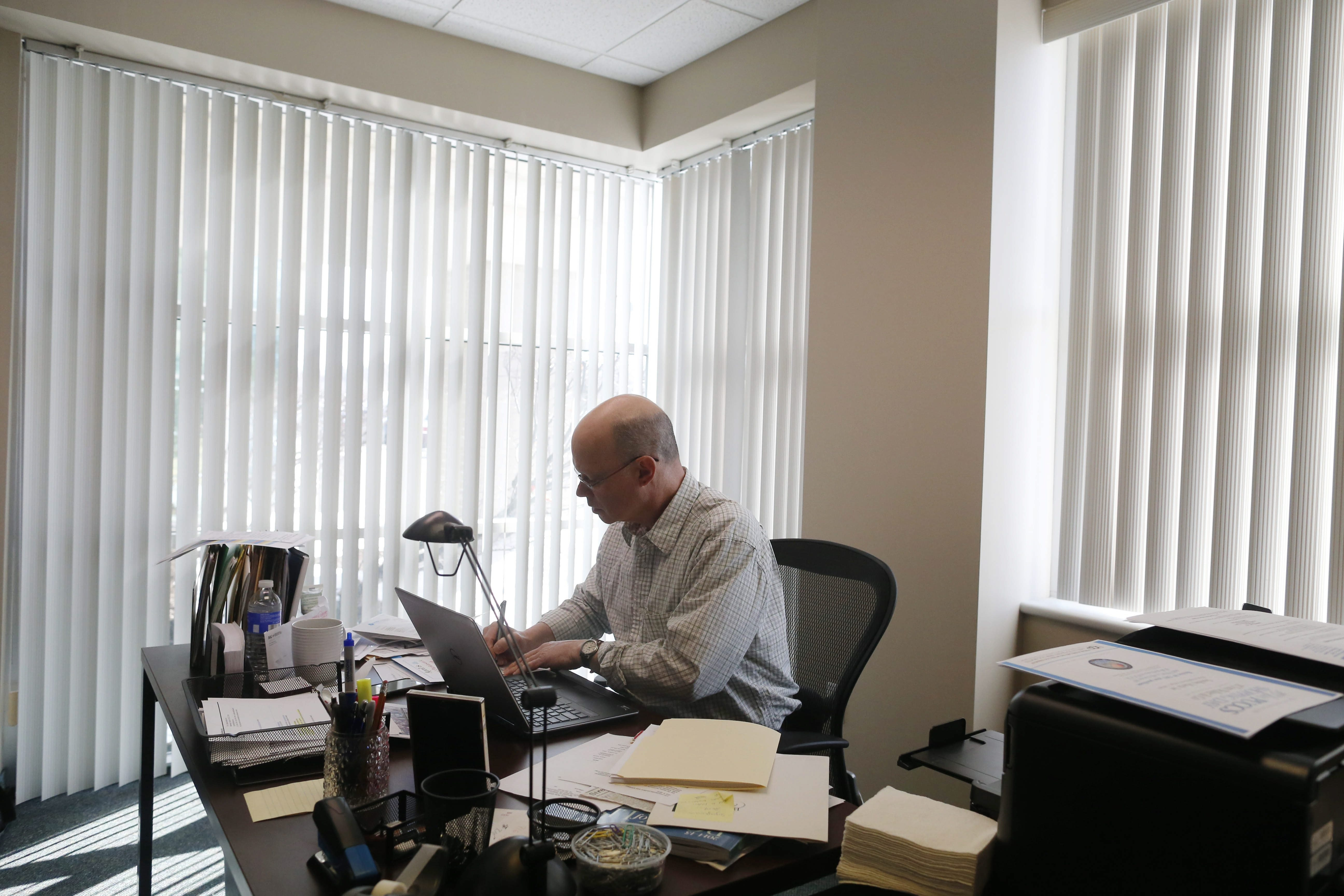 temporary office space. Christopher Jamele, Executive Director Of The National Parkinson Foundation Western New York, Works Temporary Office Space