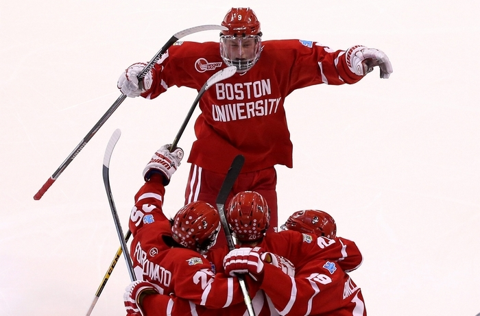 Jack Eichel of Boston University jumps for joy after his team scored a goal during the NCAA tournament. (Getty Images)