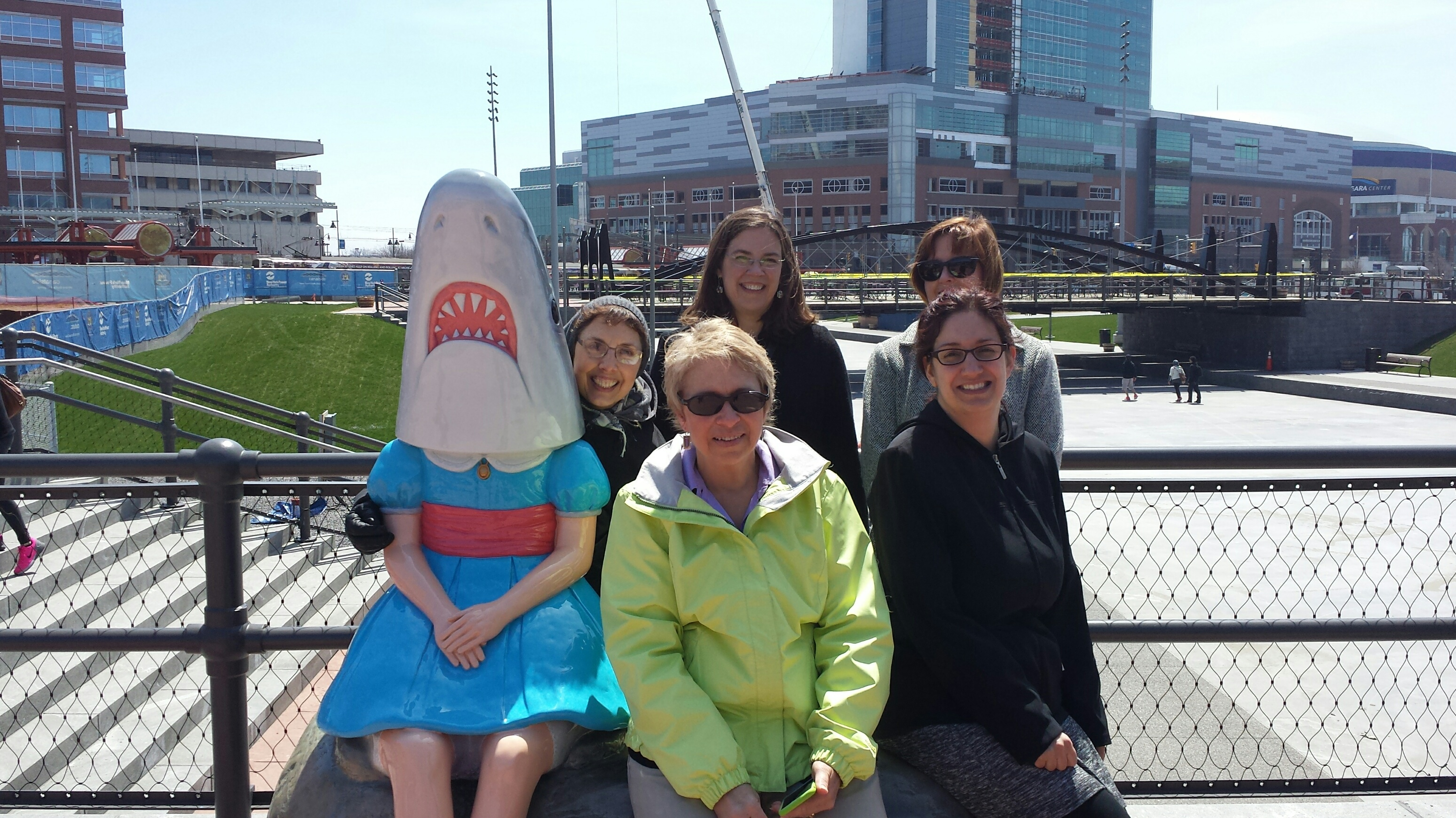 Several of those who participated  Wednesday  in National Walk at Lunch Day in downtown Buffalo stopped to pose for photos at Canalside with 'Shark Girl.' (Scott Scanlon)