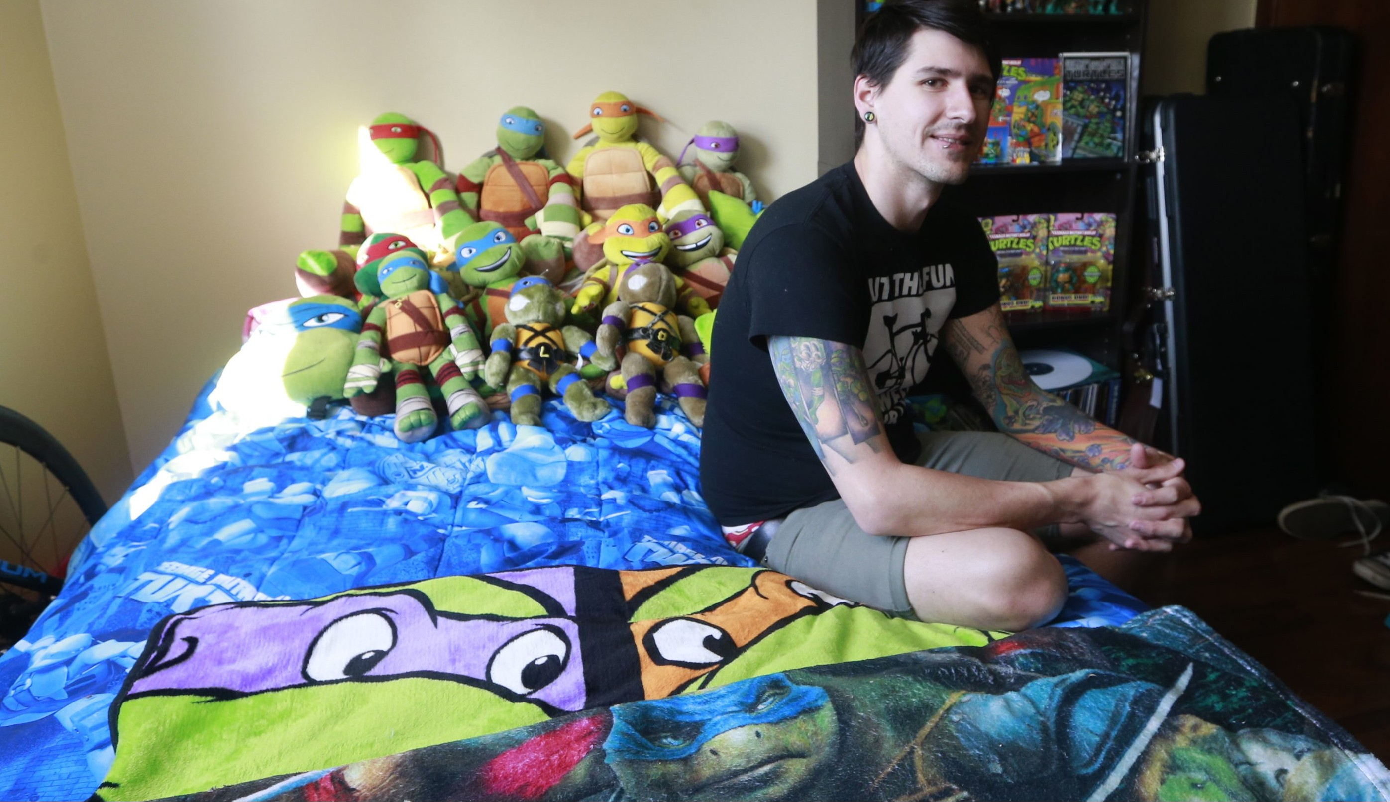 Joseph Raab of Lancaster is a big fan of the Teenage Mutant Ninja Turtles, as shown by his sleeve tattoo and his collection of Ninja Turtles memorabilia.