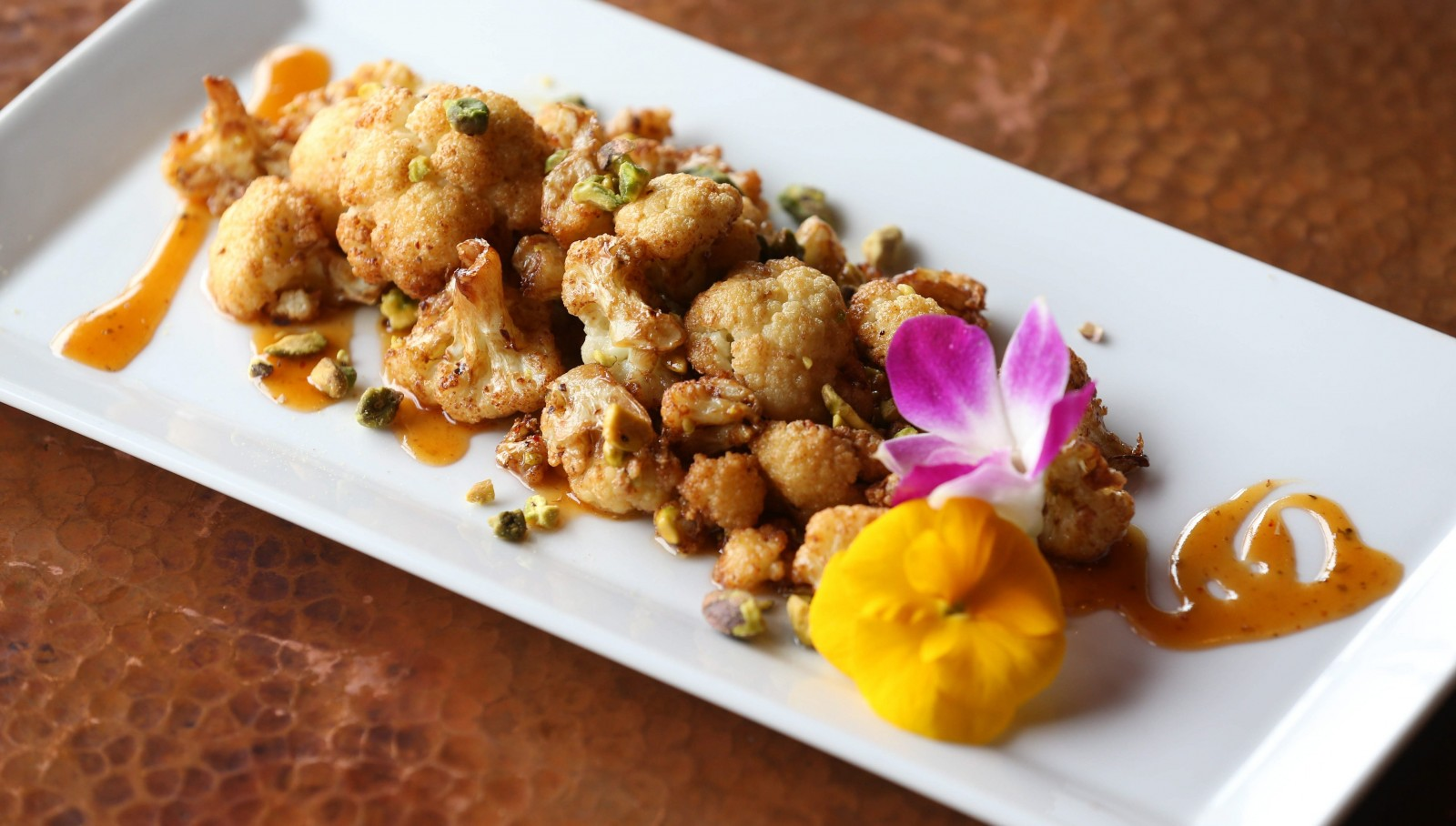 The Coliflor Frito (fried cauliflower) at Brioso by Butterwood has a coating of honey-chipotle sauce. (Sharon Cantillon/Buffalo News)