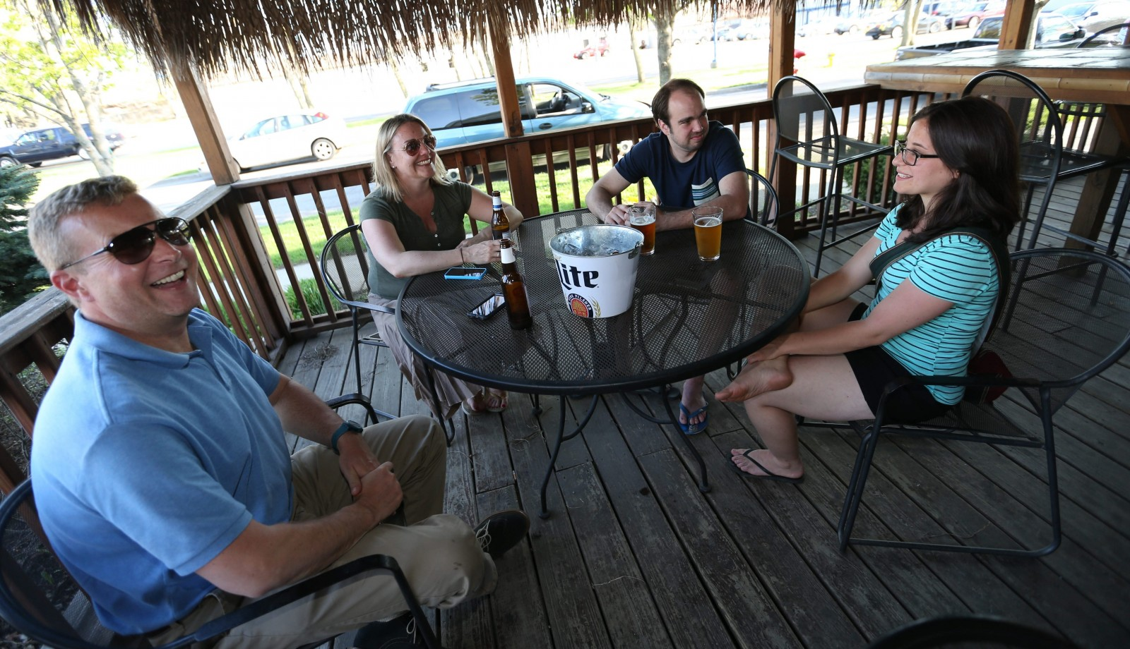Joe Sygnatur, left, Lisa Heffle, her brother Sean Heffle and Bethany Cinelli enjoy the pleasant weather on the patio at Rafferty's Bar & Grill. (Sharon Cantillon/Buffalo News)