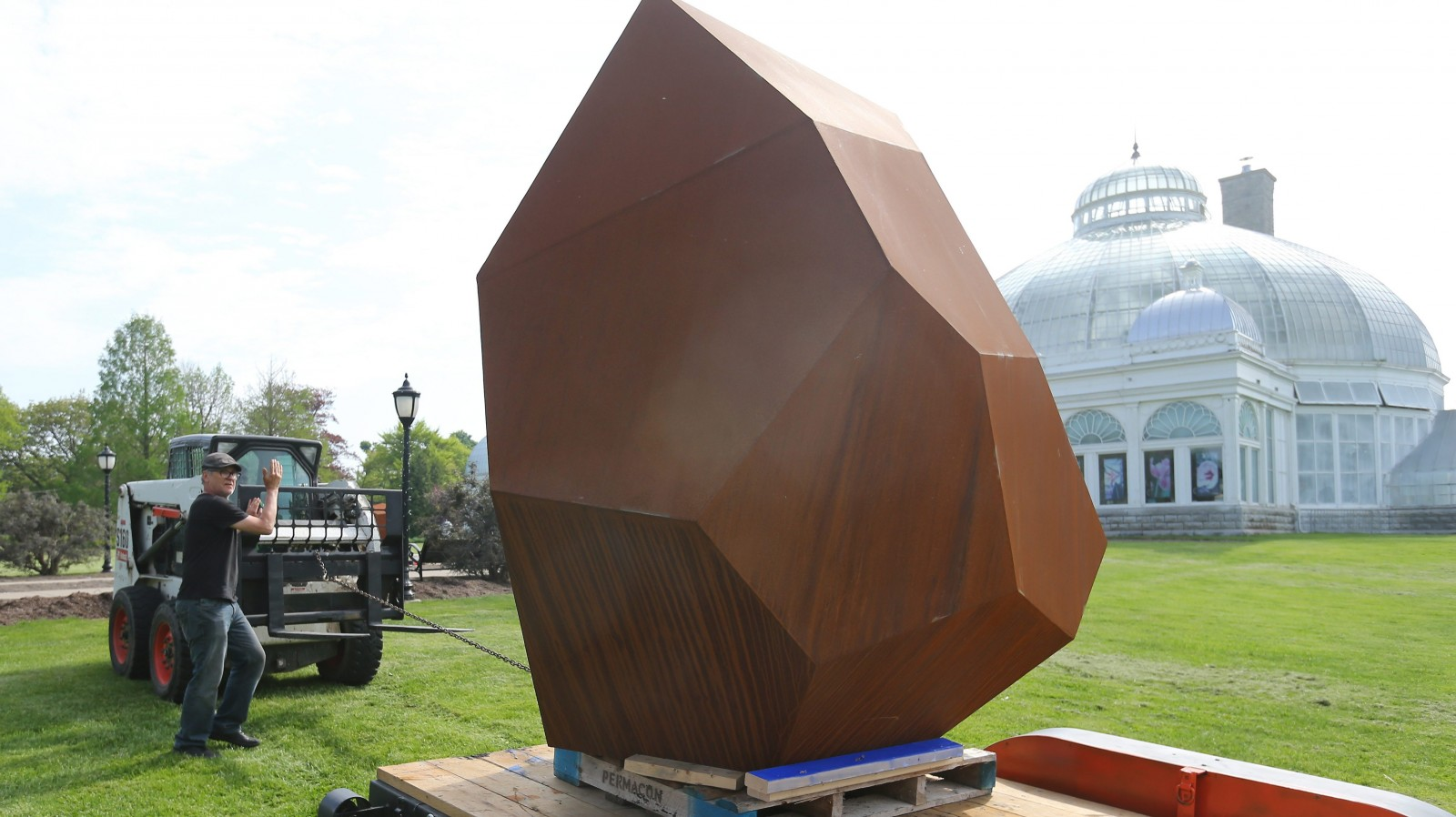 Artist Shayne Dark installs pieces of his artwork in front of the Buffalo and Erie County Botanical Gardens in Buffalo on May 18. (Mark Mulville/Buffalo News)