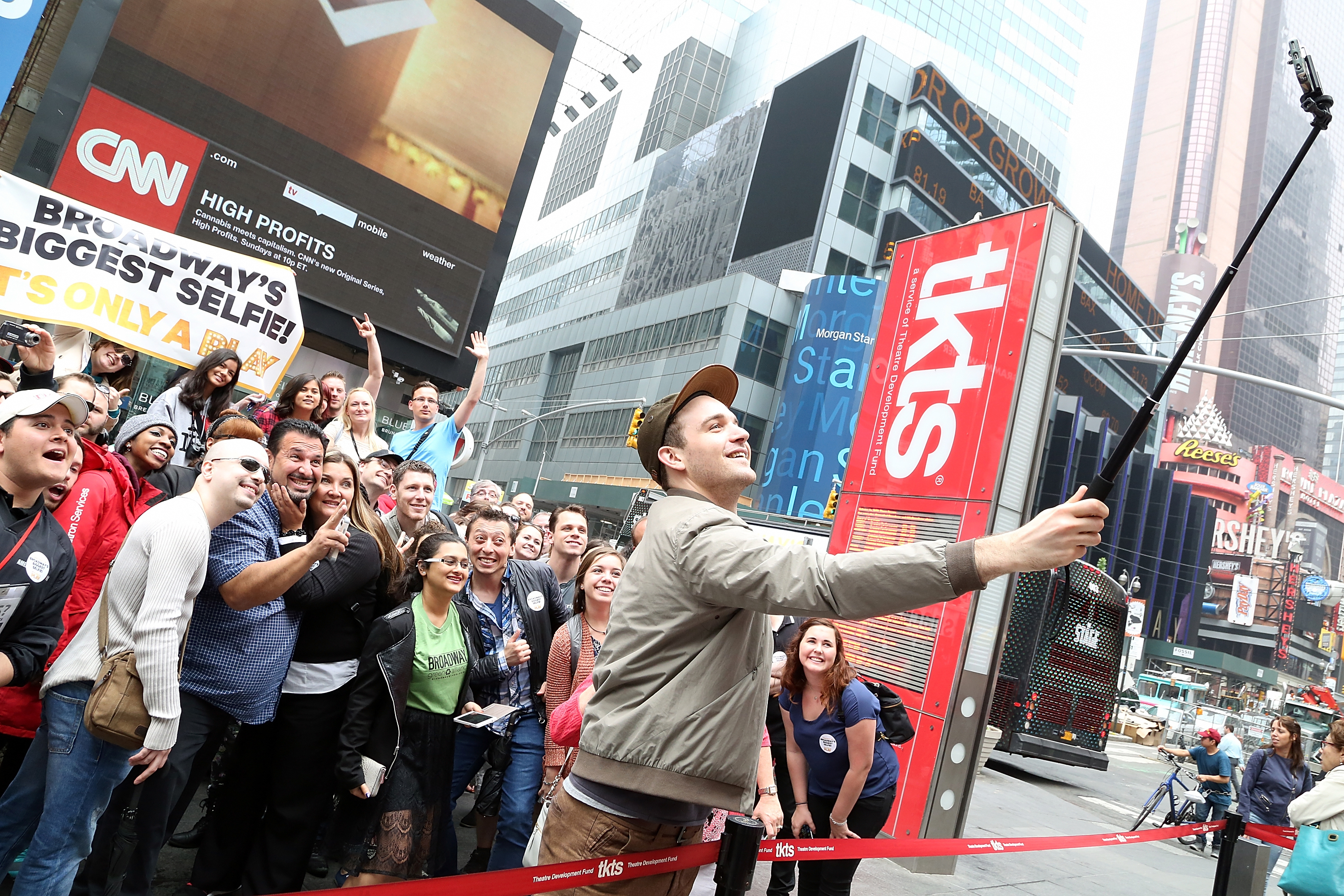 "Selfie on stairs: Broadway actor Micah Stock takes a selfie with fans as the comedy ""It's Only A Play"" attempts Broadway's Biggest Selfie at Times Square Stairs Tuesday in New York City."