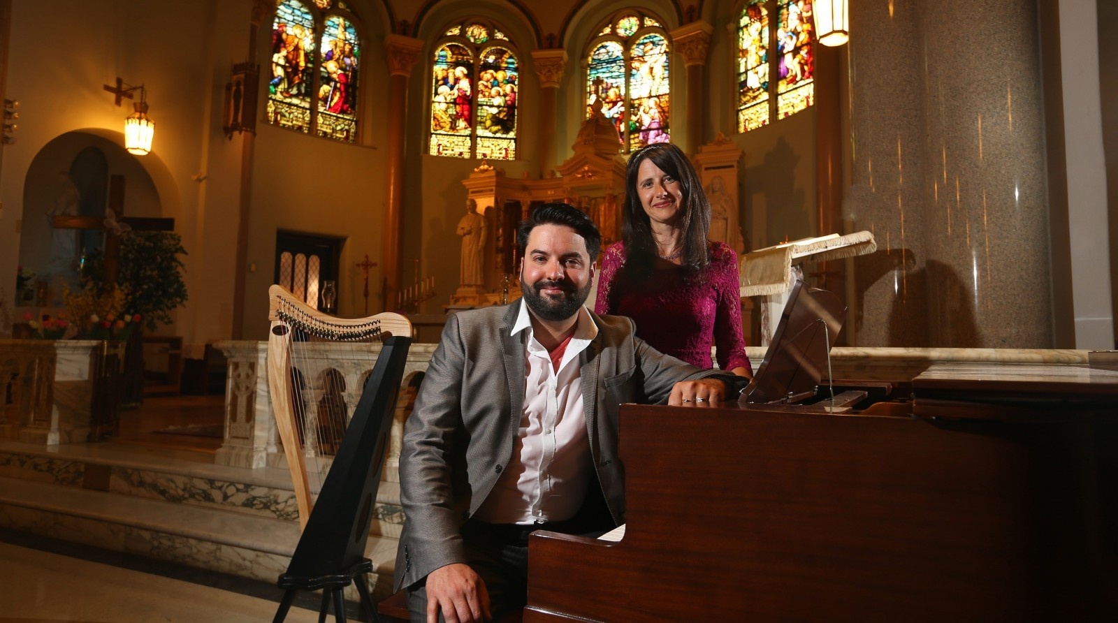 Cory James Gallagher and Amy Gallagher take a break from rehearsing at Holy Family Church on Monday.